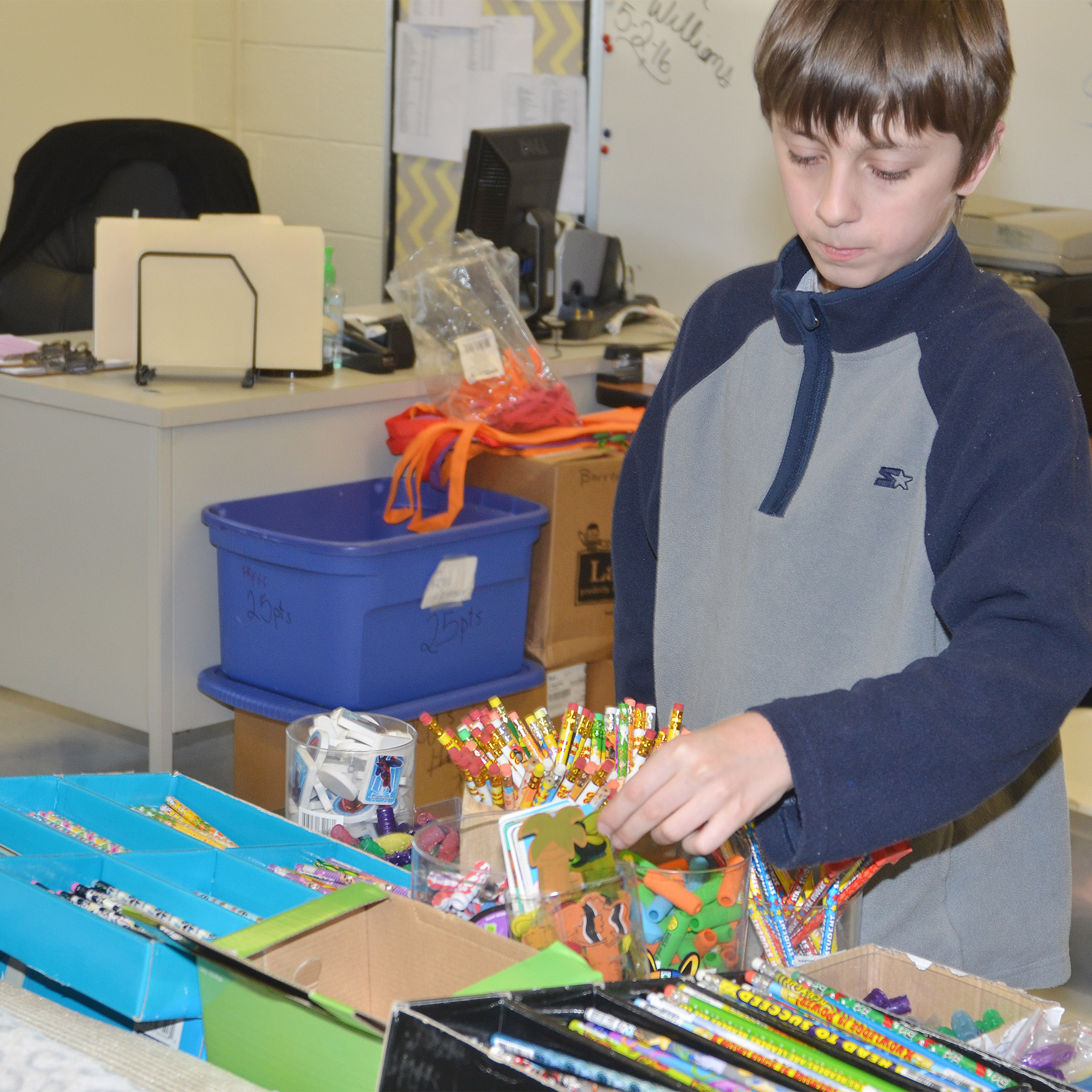CMS seventh-grader Logan Nelson shops with his AR points.