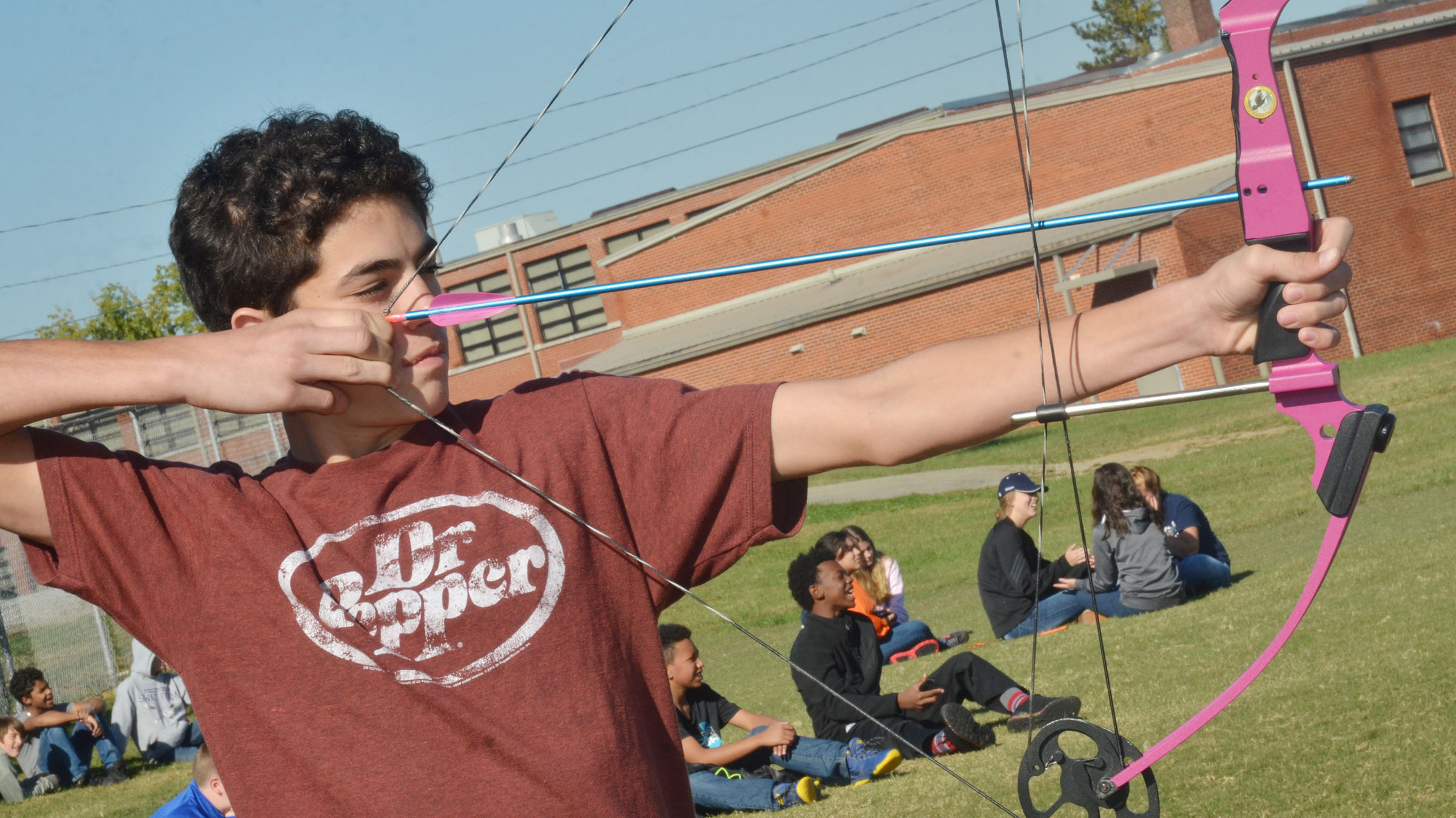 CMS eighth-grader Kameron Smith shoots an arrow.