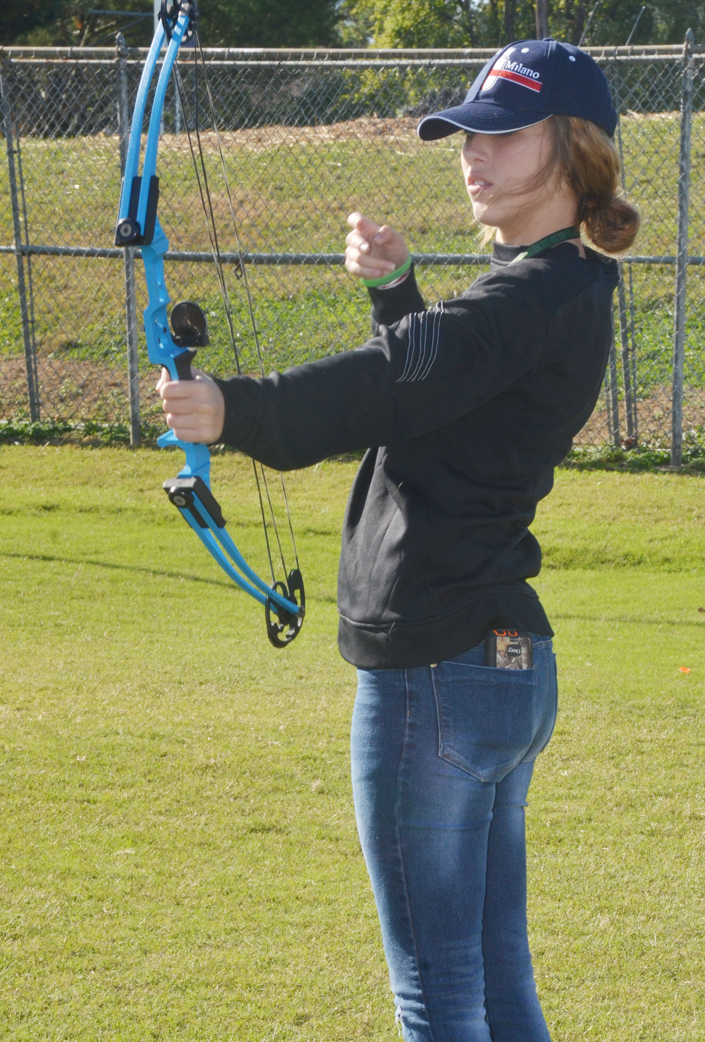 CMS eighth-grader Autumn Harvey shoots an arrow.