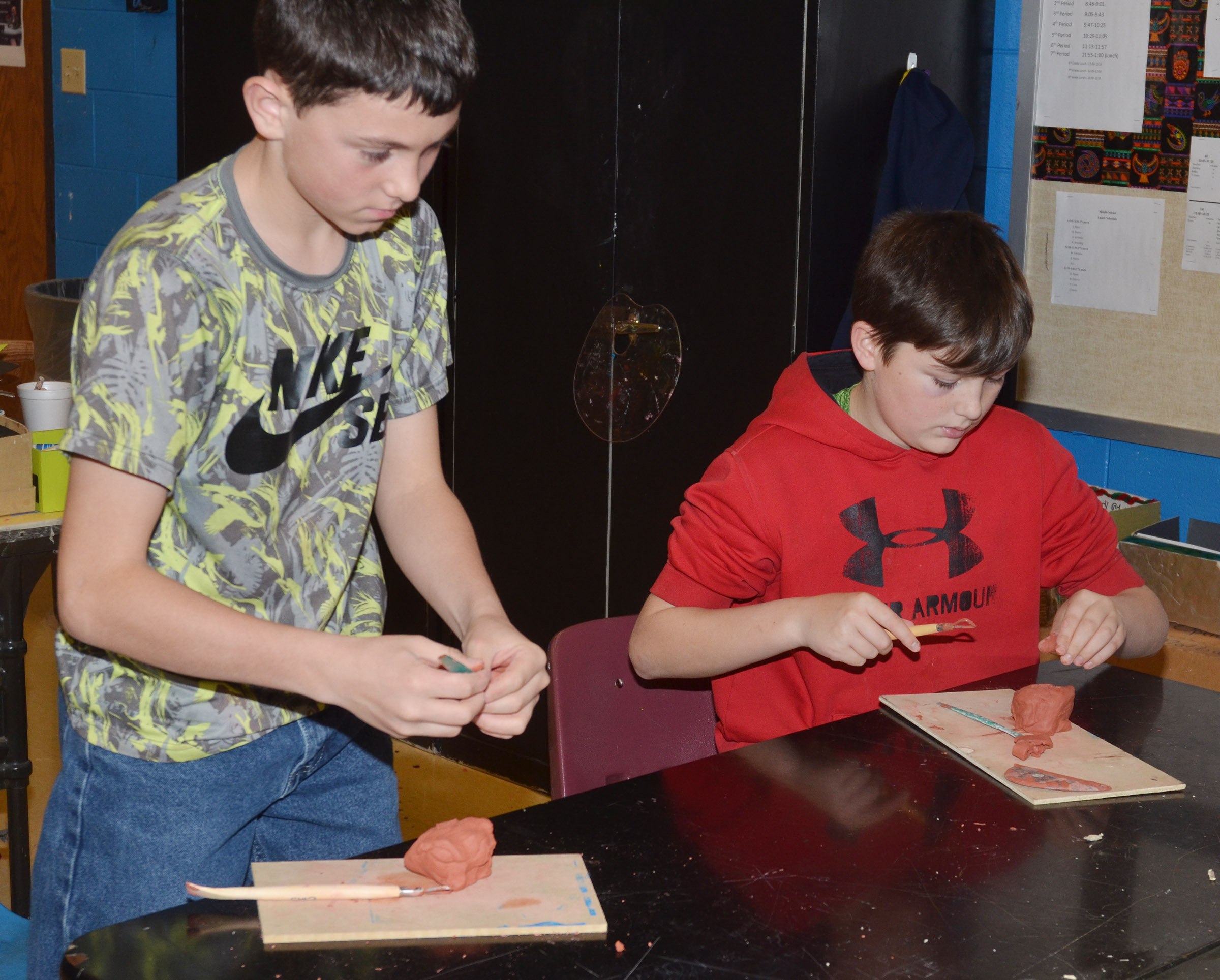 CMS eighth-graders Dakota Harris, at left, and Cohen Moon work with clay.
