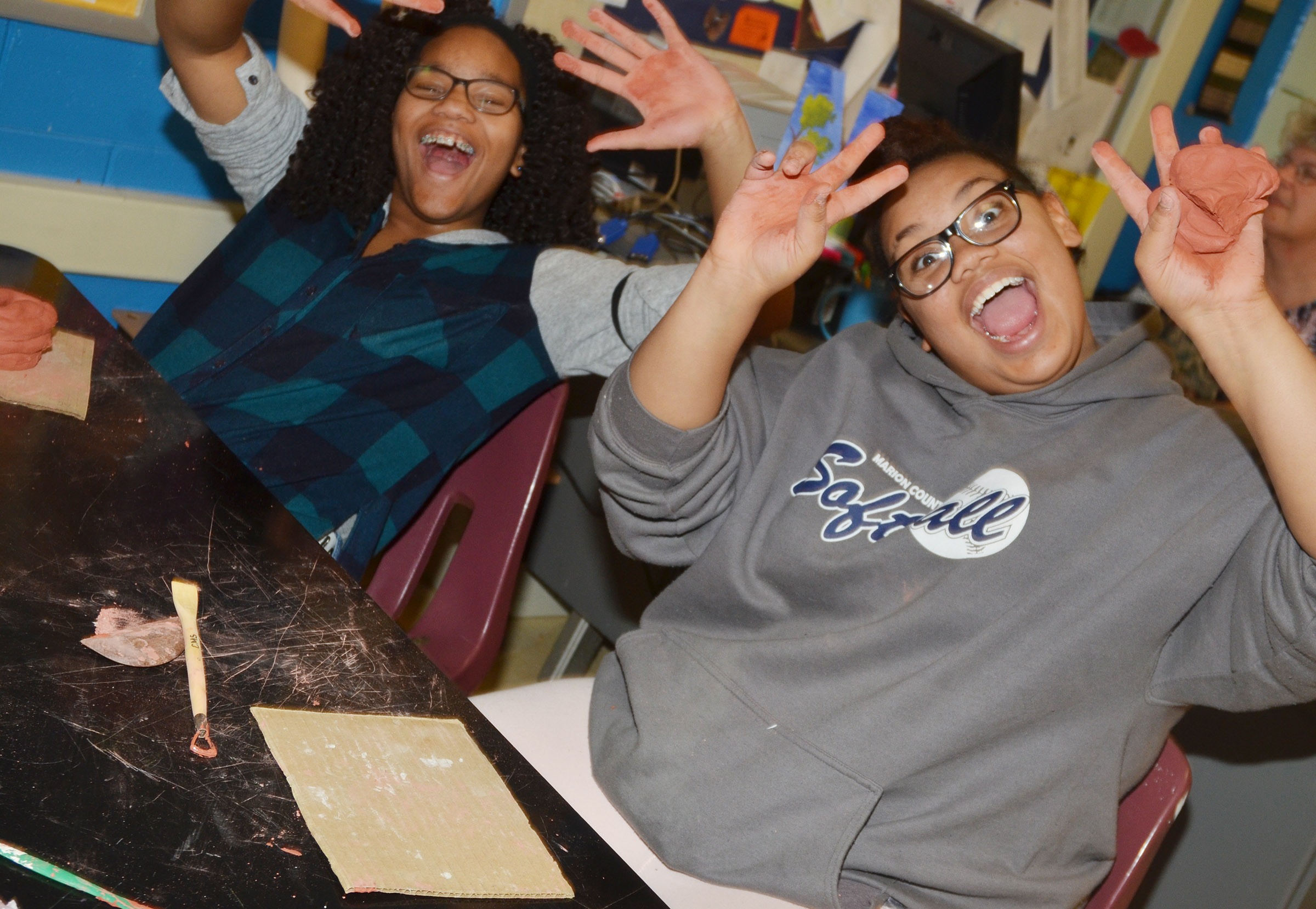 CMS seventh-grader Antaya Epps, at left, and eighth-grader Brae Washington have fun while working with clay.