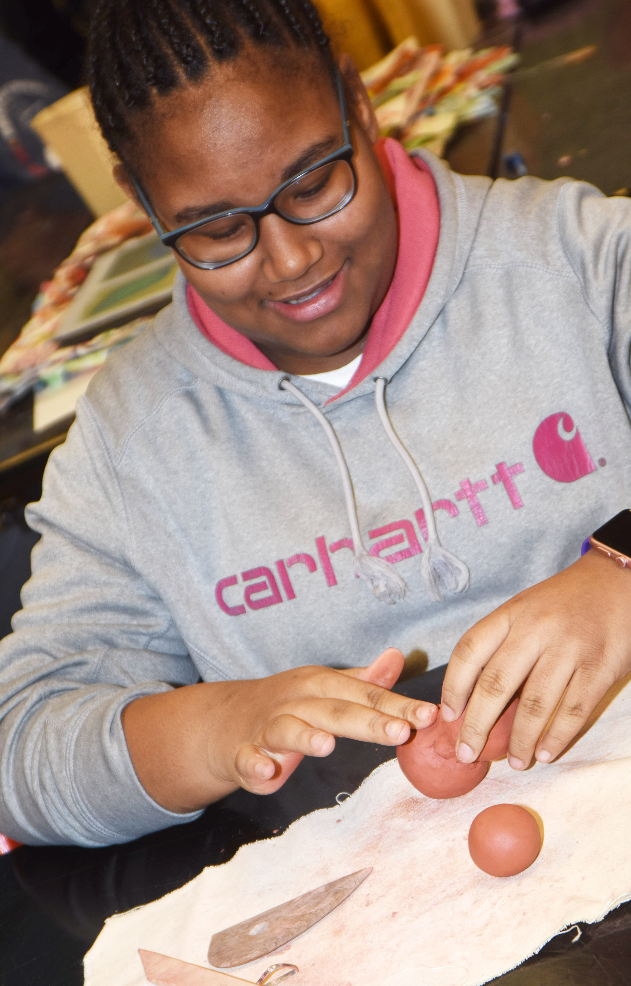 CMS seventh-grader KyAshia Mitchell shapes her clay.