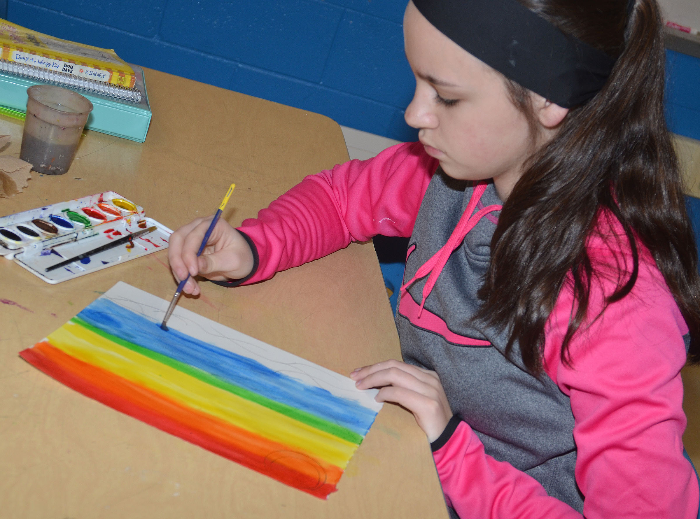 CMS seventh-grader Karley Morris paints her color wheel design.