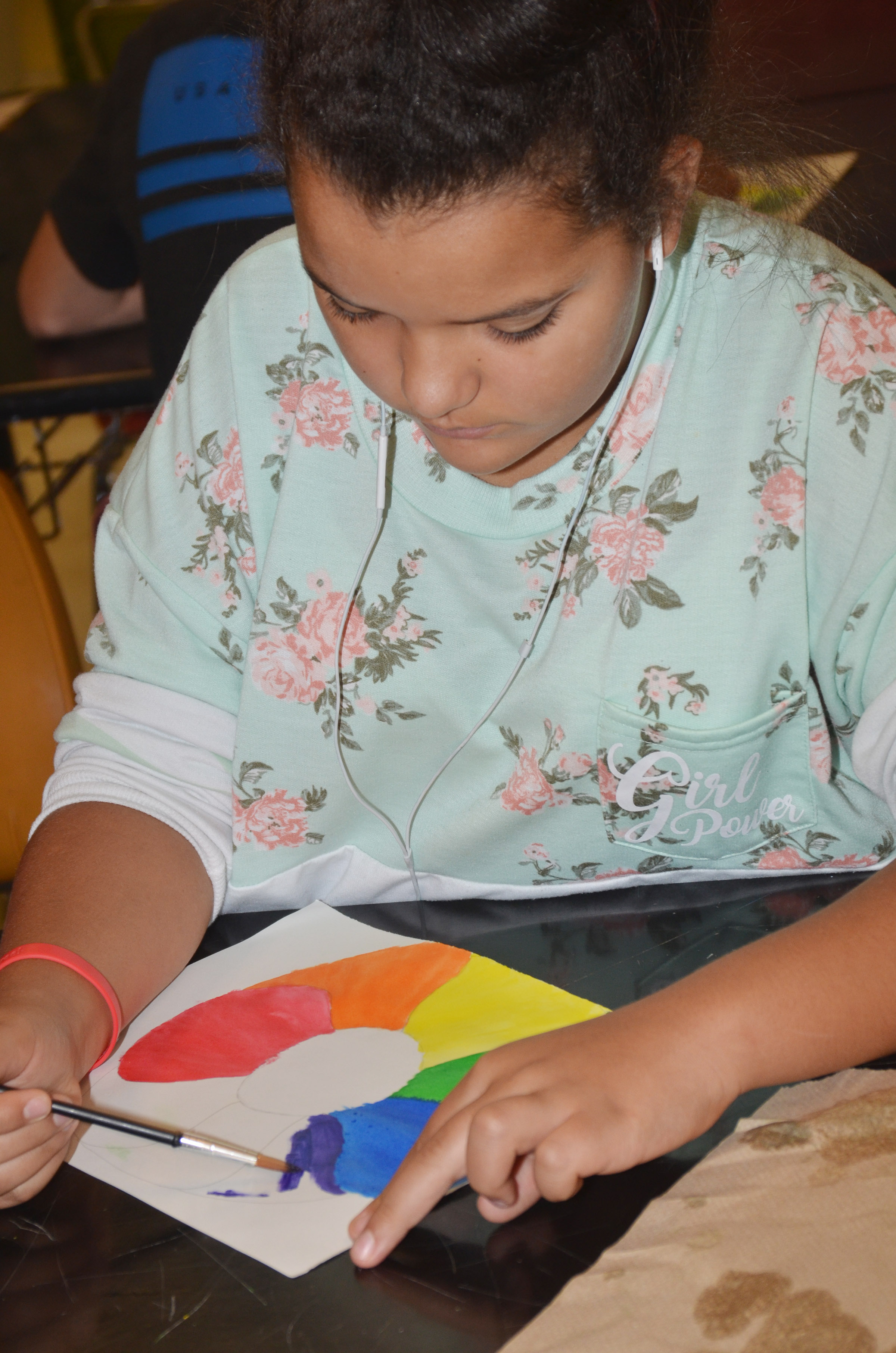 CMS sixth-grader Gracie Taylor paints her color wheel.
