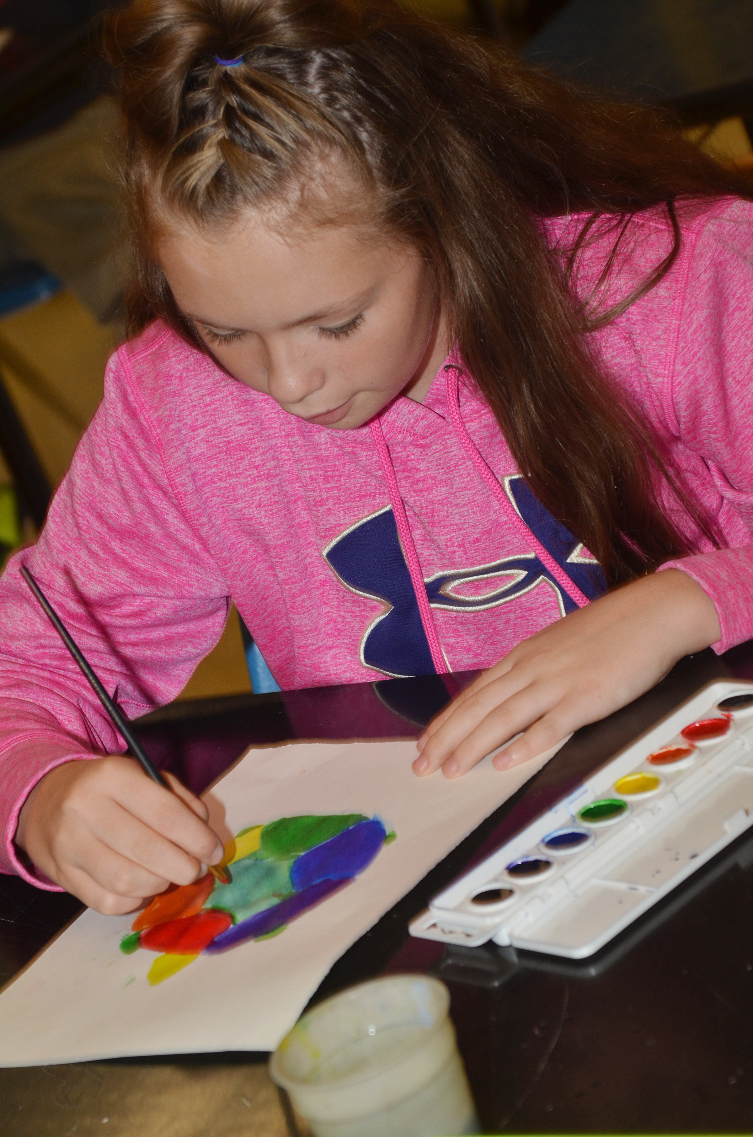 CMS sixth-grader CheyAnn Edwards paints her color wheel.