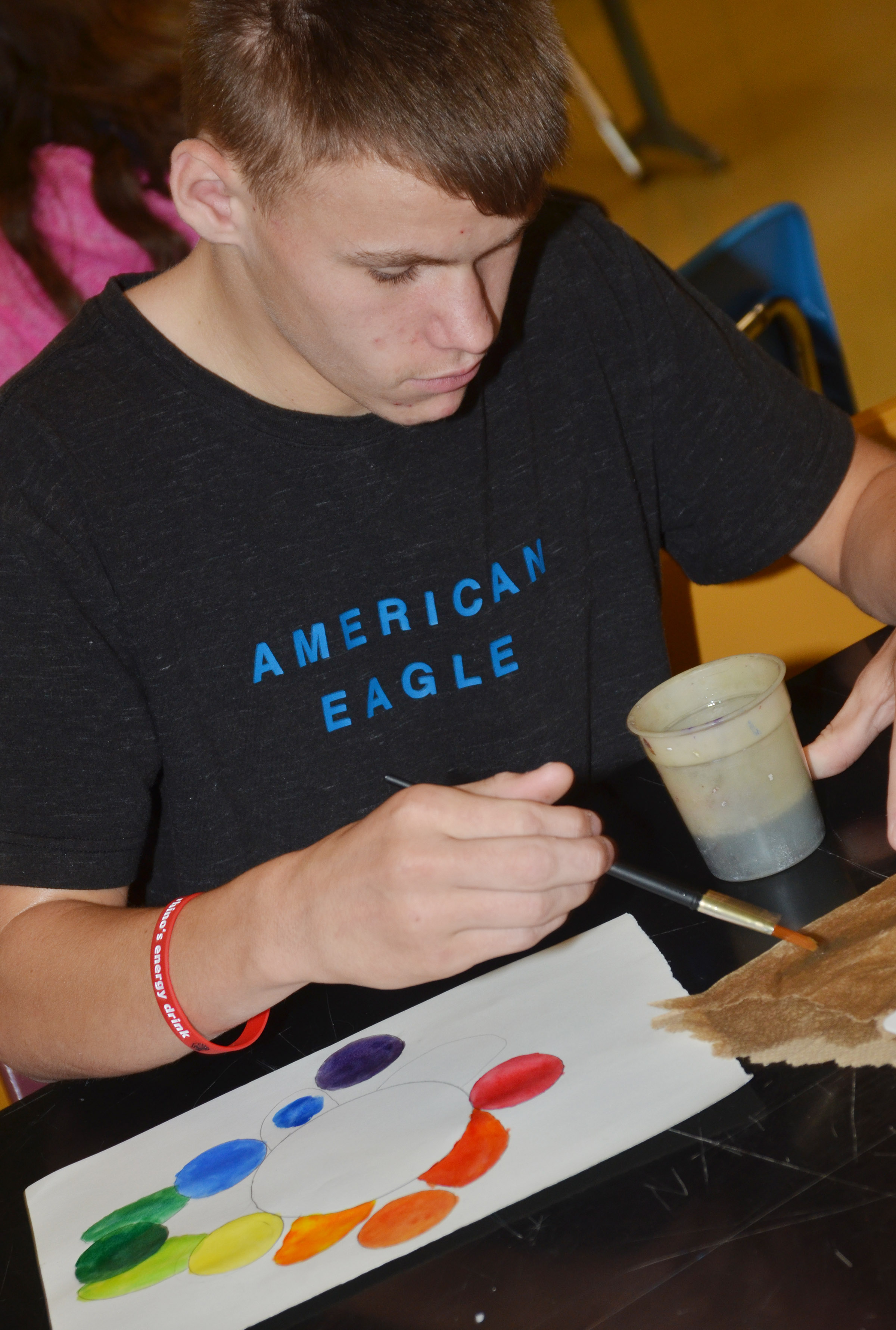 CMS eighth-grader Dalton Reynolds paints his color wheel.