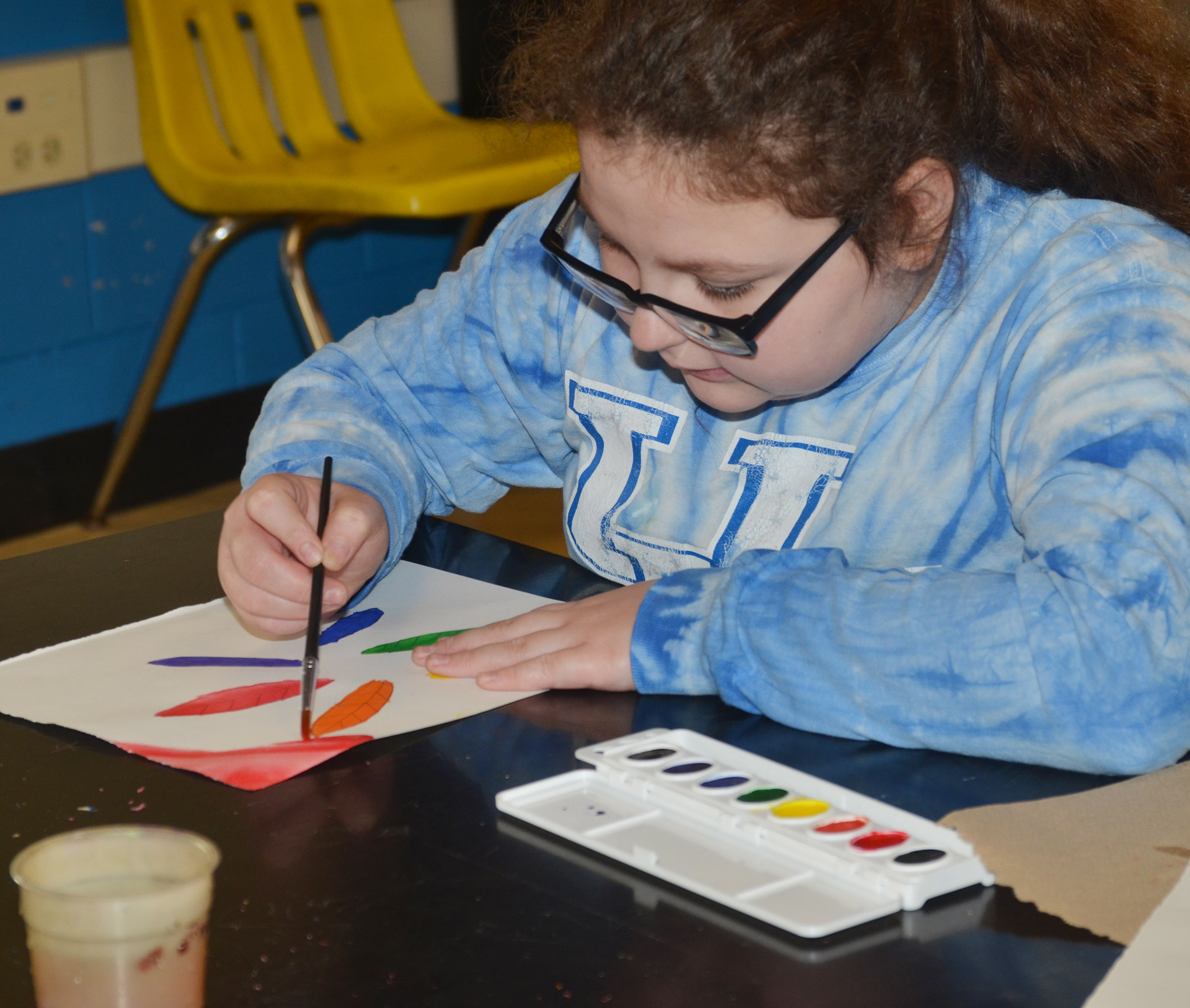 CMS sixth-grader Chloe Mitchell paints her color wheel.