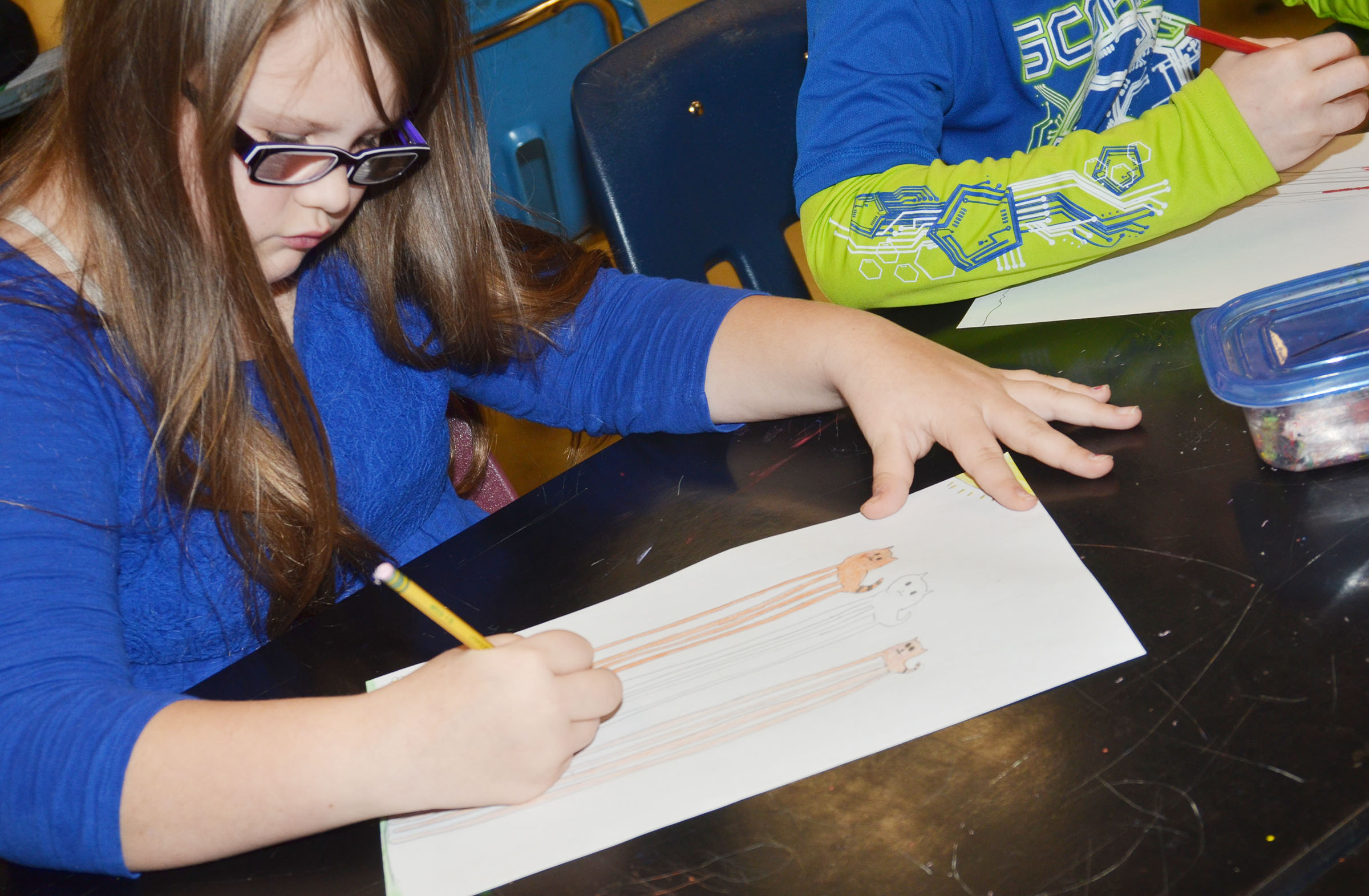CMS fifth-grader Kylee Cox colors her animals in Salvador Dali's style of surrealism.