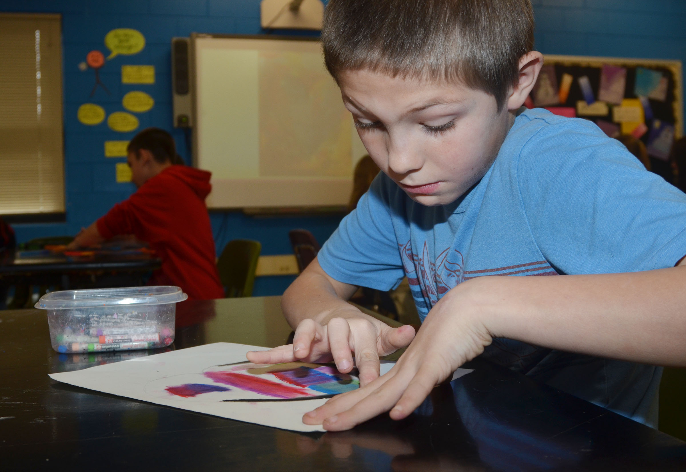 CMS fourth-grader Daniel Hellard colors his heart.