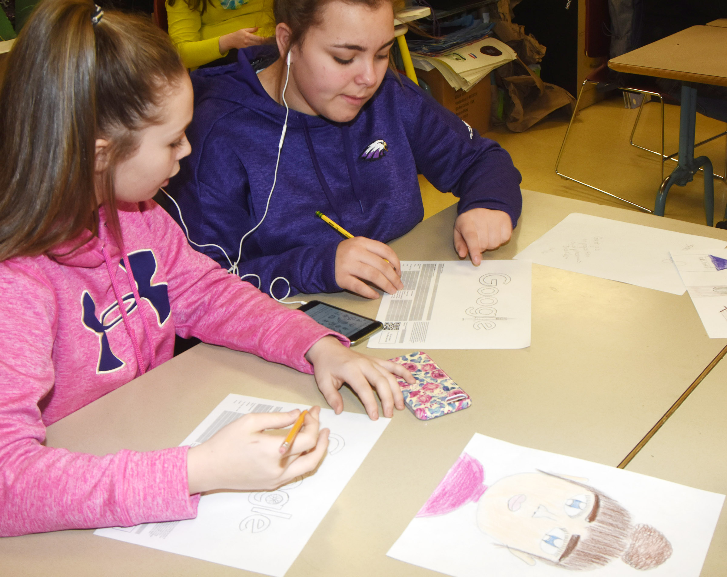 CMS seventh-graders CheyAnn Edwards, at left, and Brooklyn Mays discuss their ideas for the Doodle for Google contest.