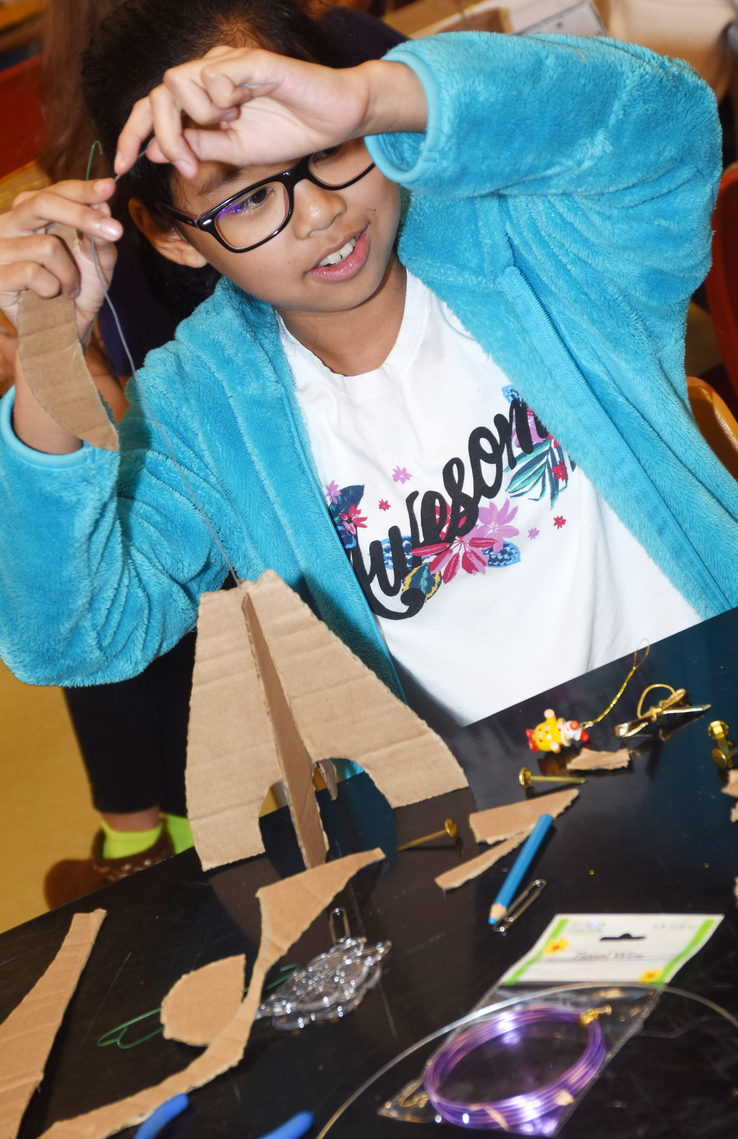 CMS seventh-grader Angelica Seng builds the base for his mobile.