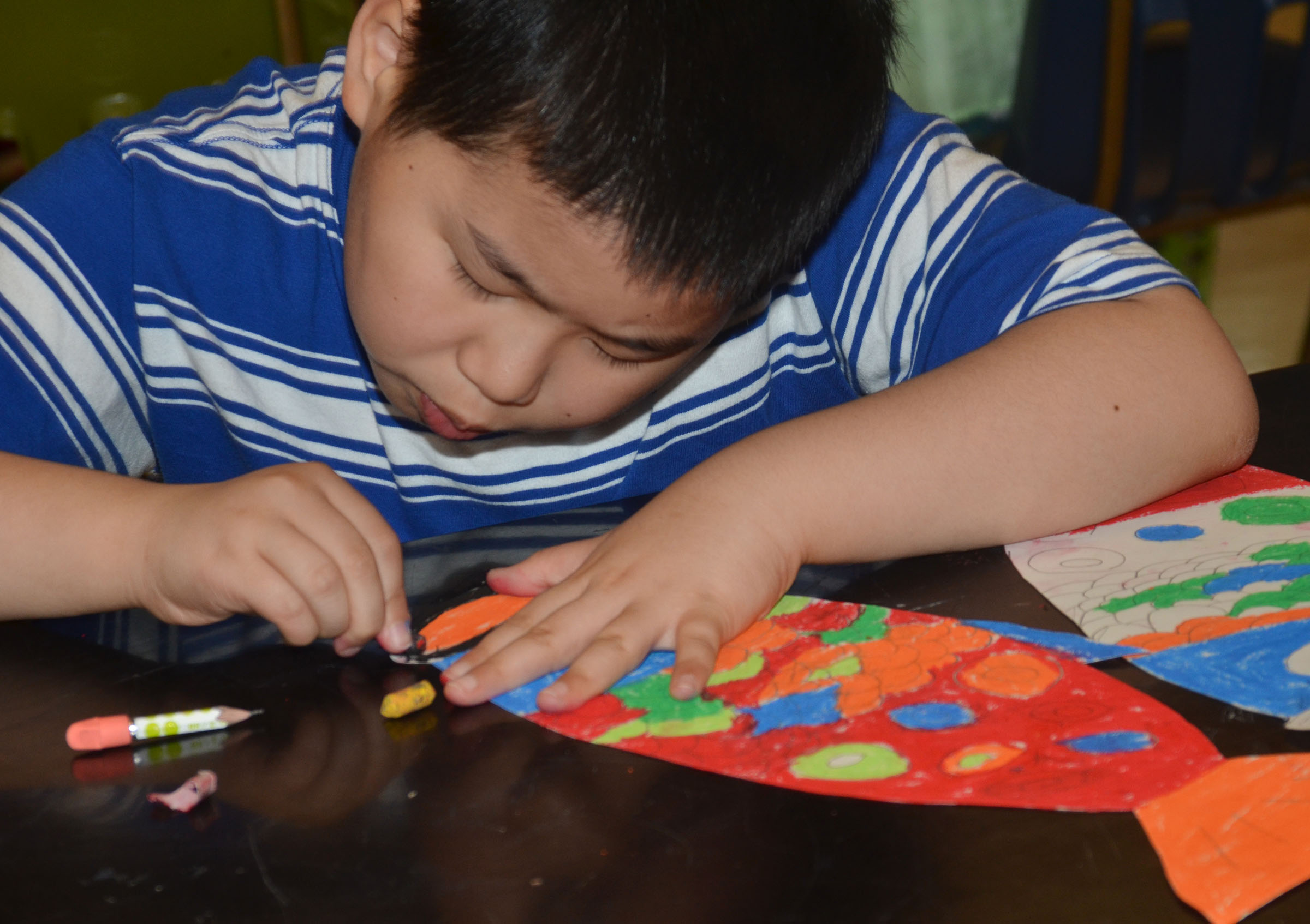 CMS fourth-grader Zhi Chen puts finishing touches on his koinobori.