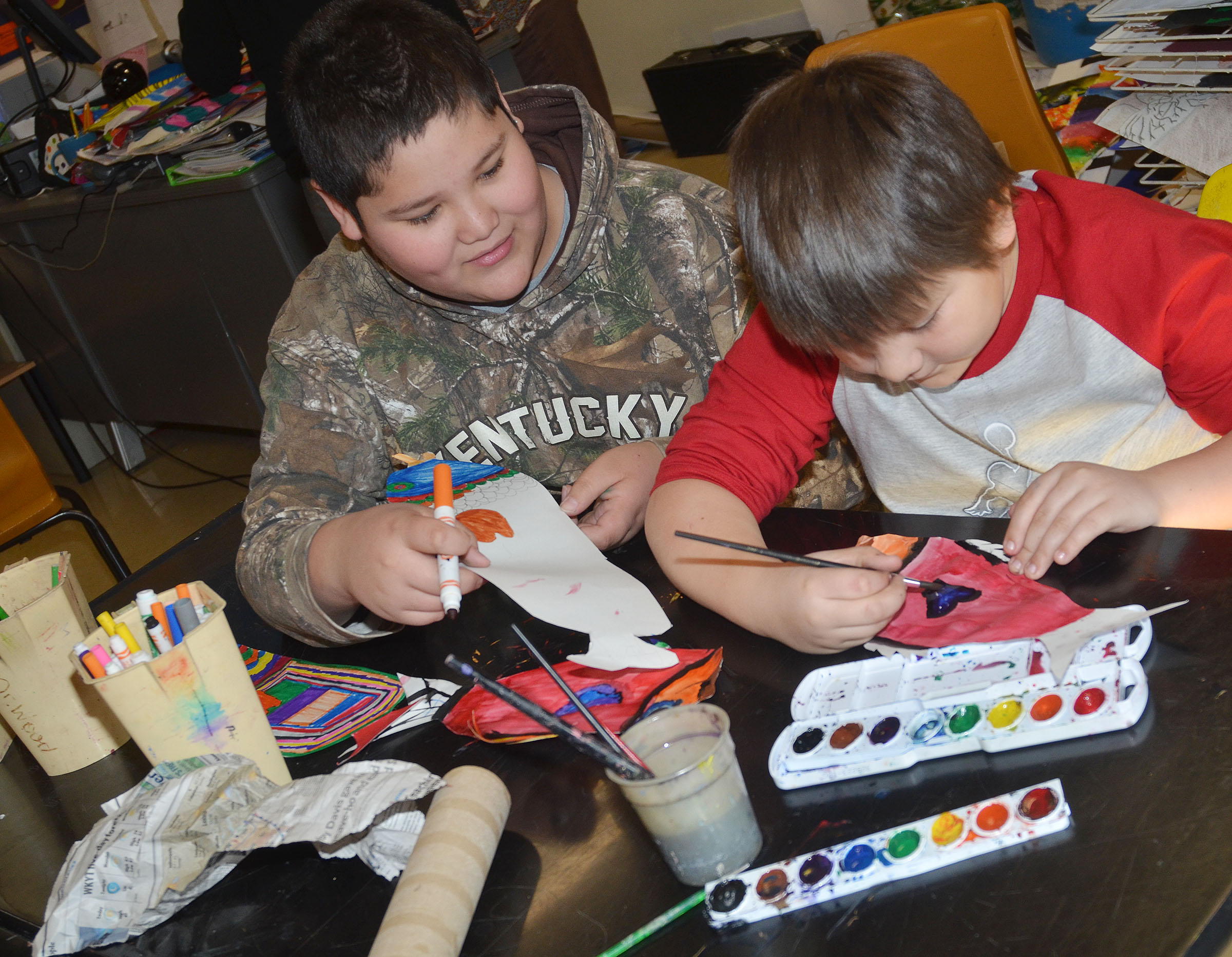 CMS fifth-graders Xavier Florez, at left, and Leo Lamer color and paint their koinobori.