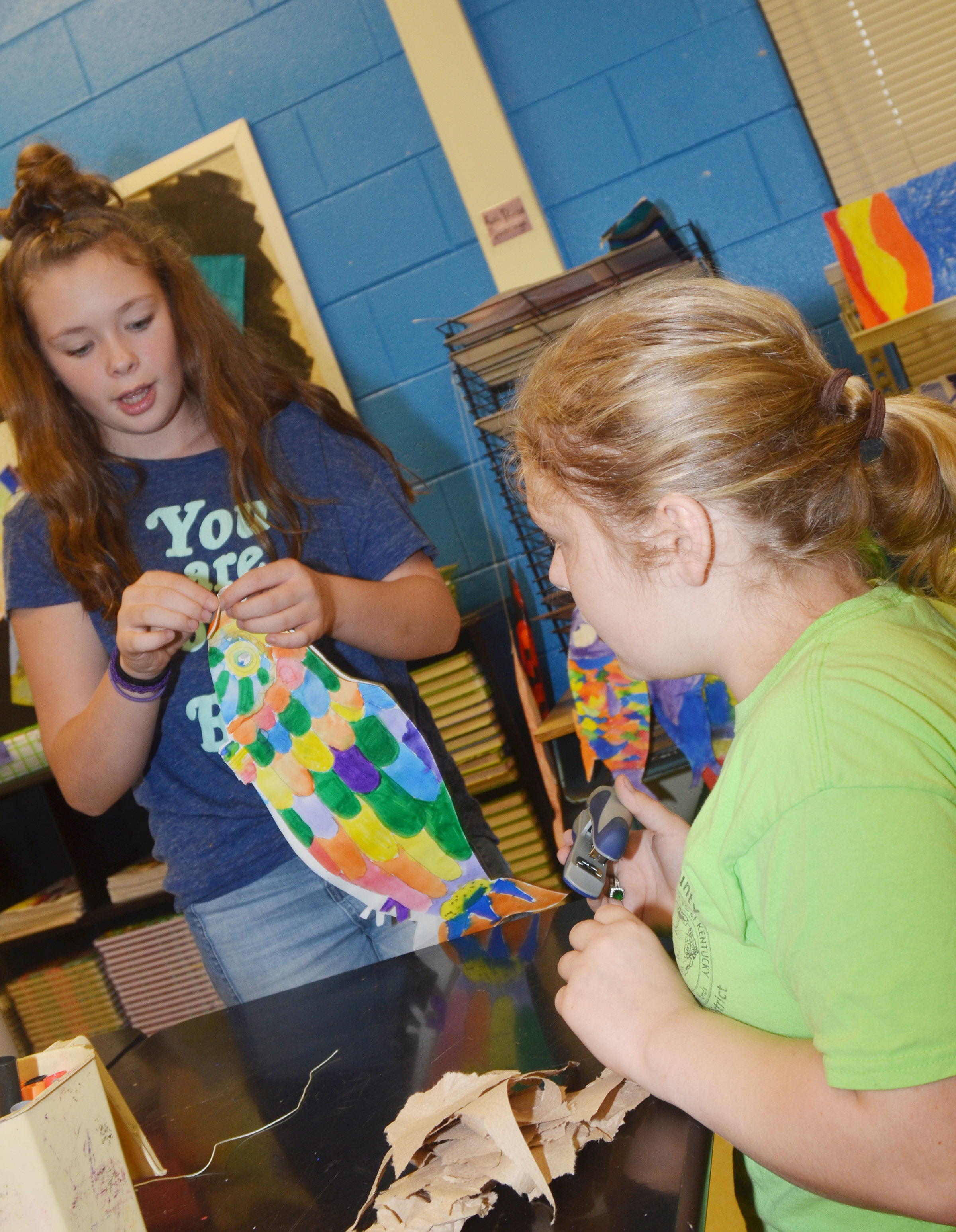 CMS sixth-graders CheyAnn Edwards, at left, and Alexis Sharp staple their koinobori together.