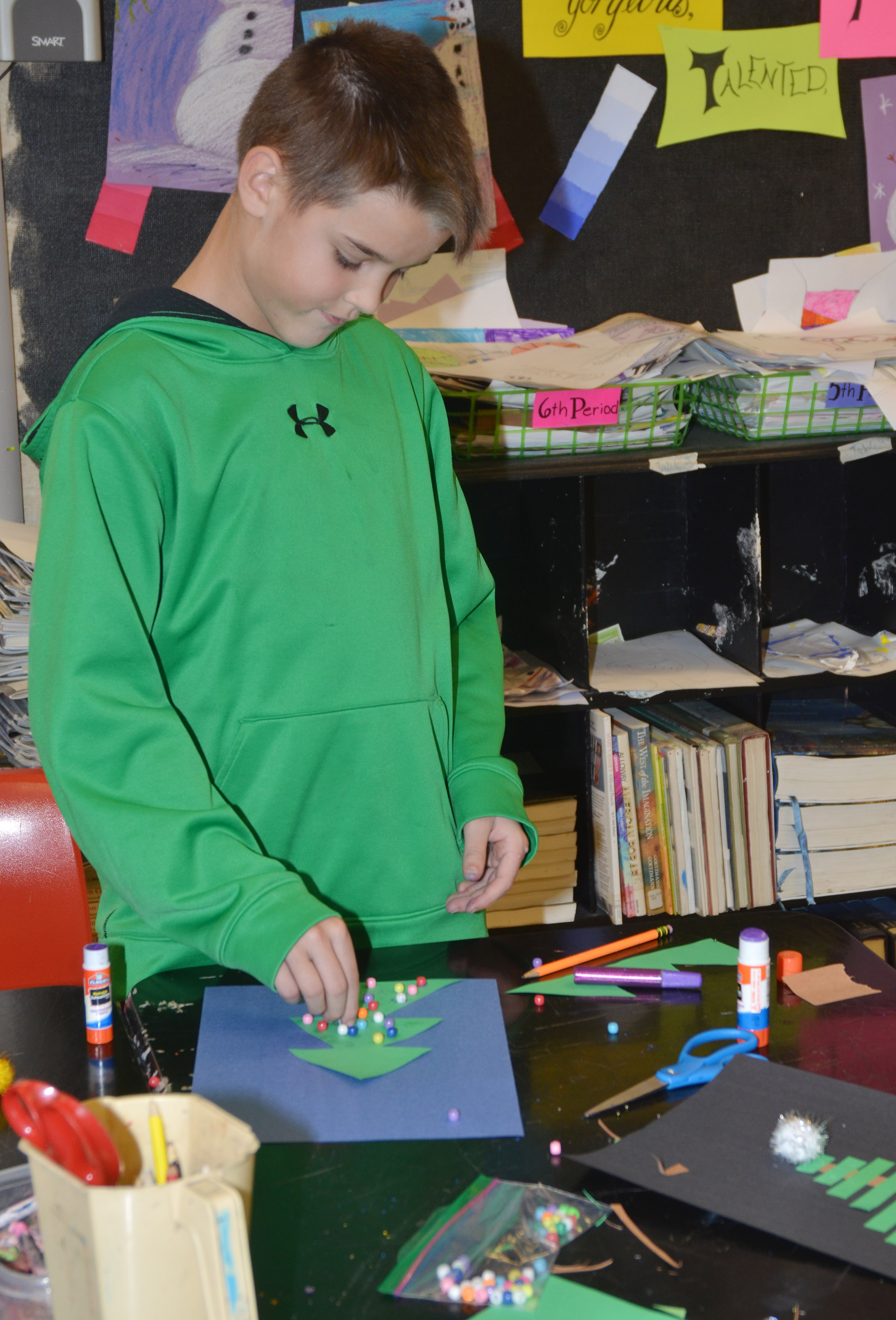 CMS fifth-grader Kaden Bloyd makes his Christmas tree.