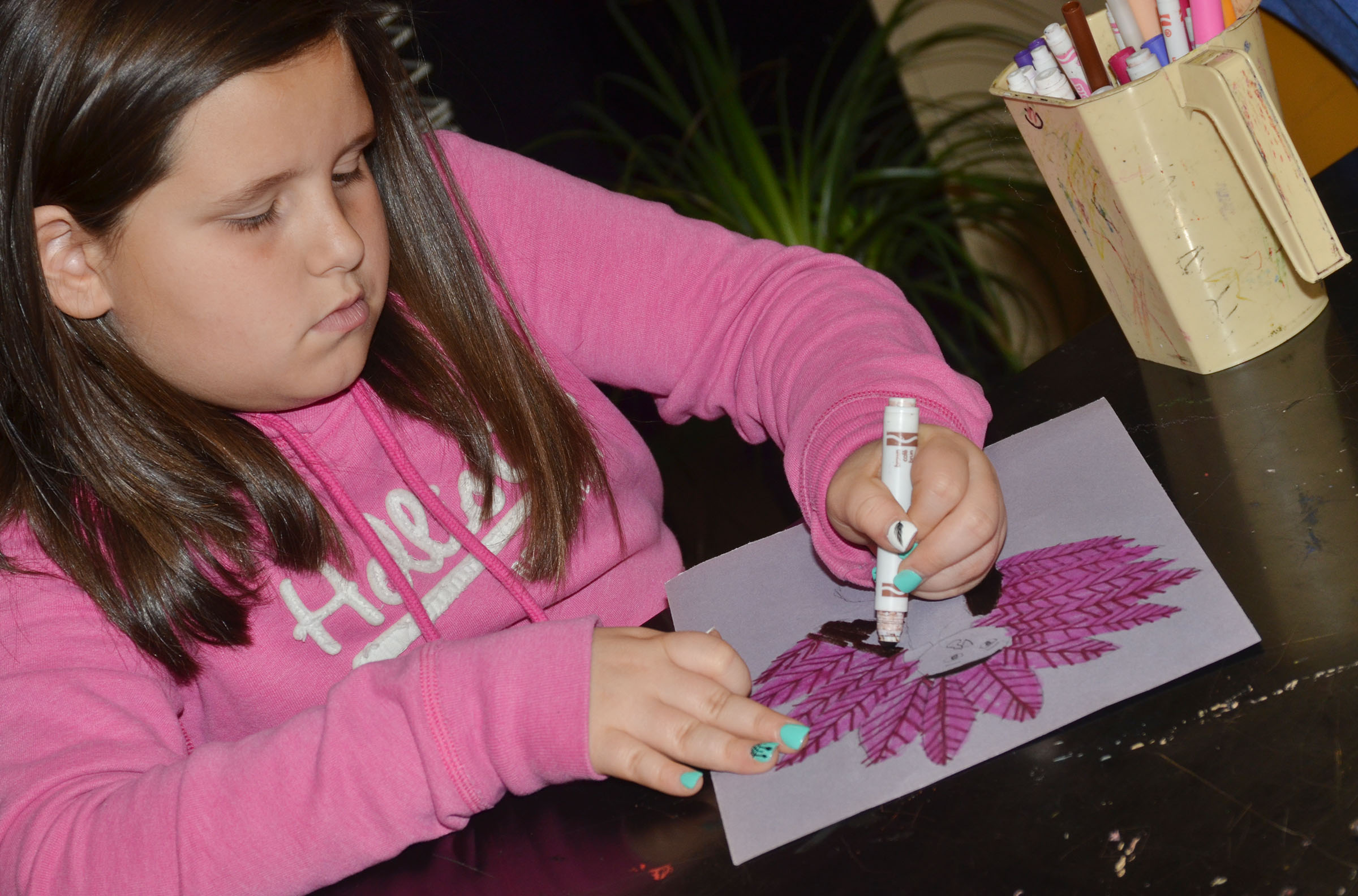 CMS fourth-grader Kaitlyn Keith colors her turkey.