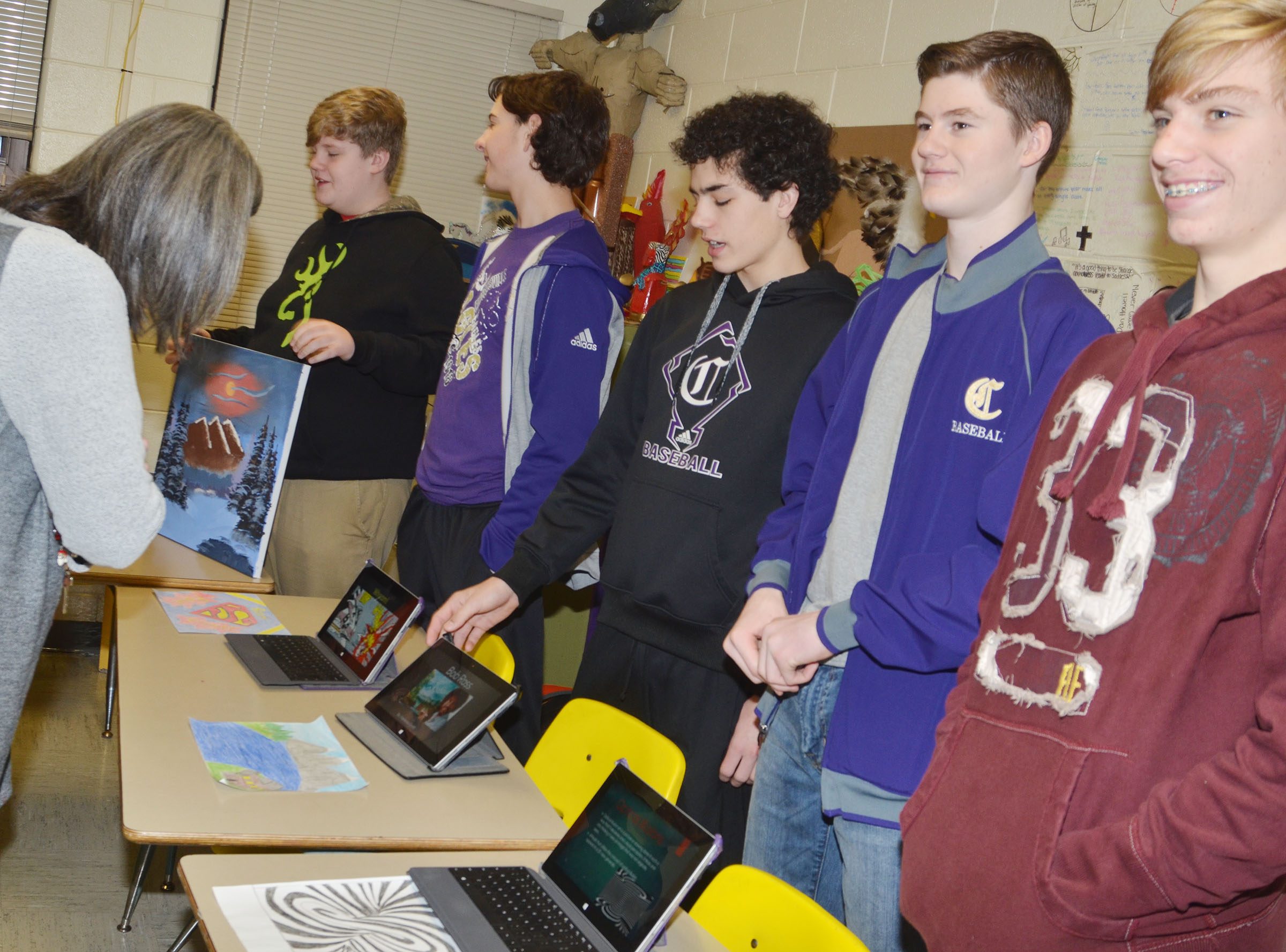 From left, CMS eighth-graders Noah Mardis, John Orberson, Kameron Smith, Tristin Faulkner and Arren Hash display their artwork.