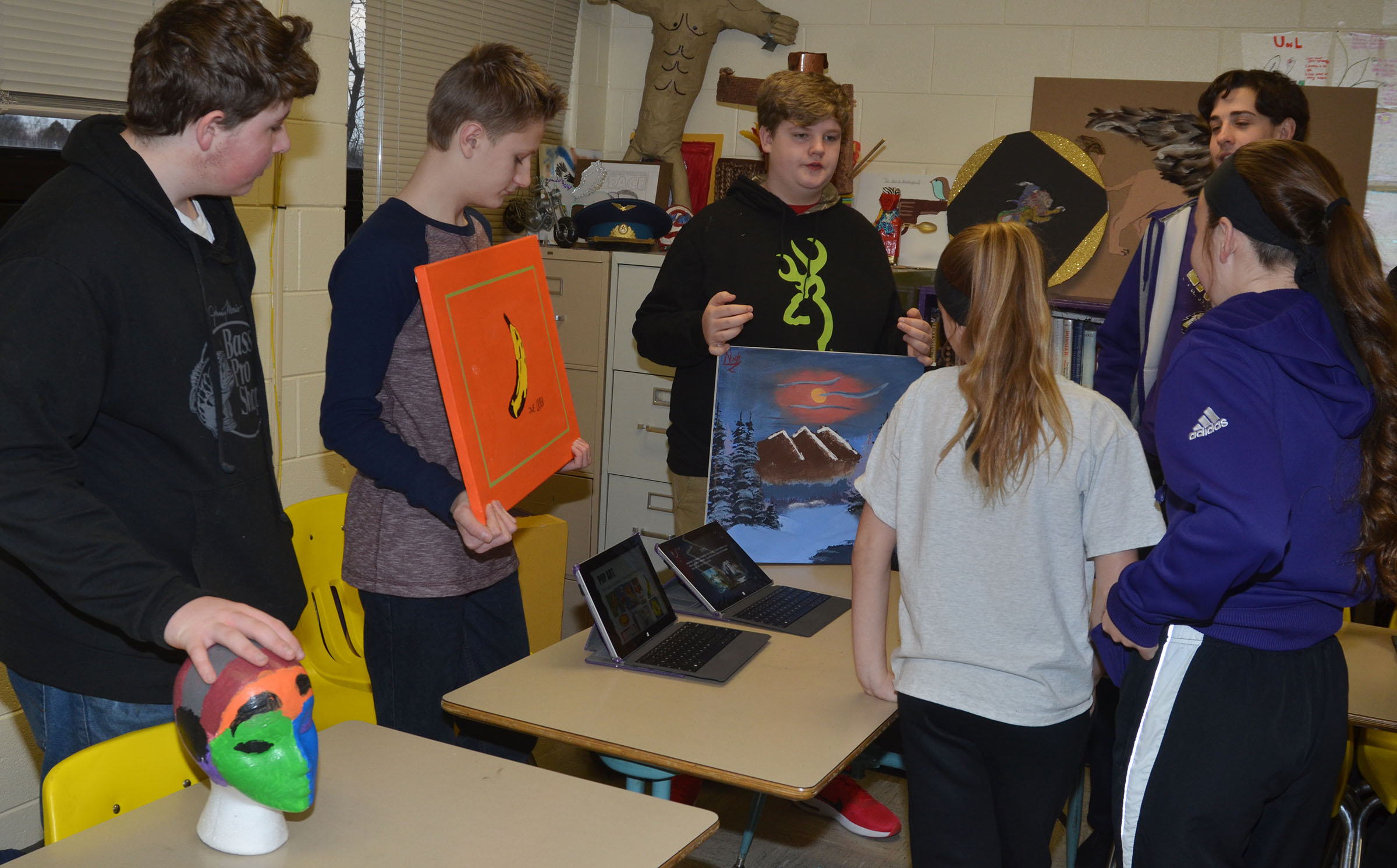 From left, CMS eighth-graders Alex Howard, Jake Dicken, Noah Mardis and John Orberson display their artwork.