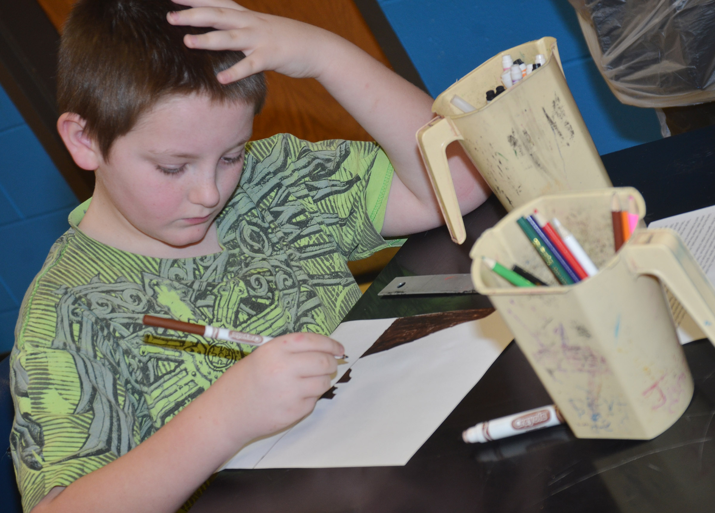 "CMS fourth-grader Kanan Bruce draws a pictured based on the story ""The Selfish Giant"" by Oscar Wilde."