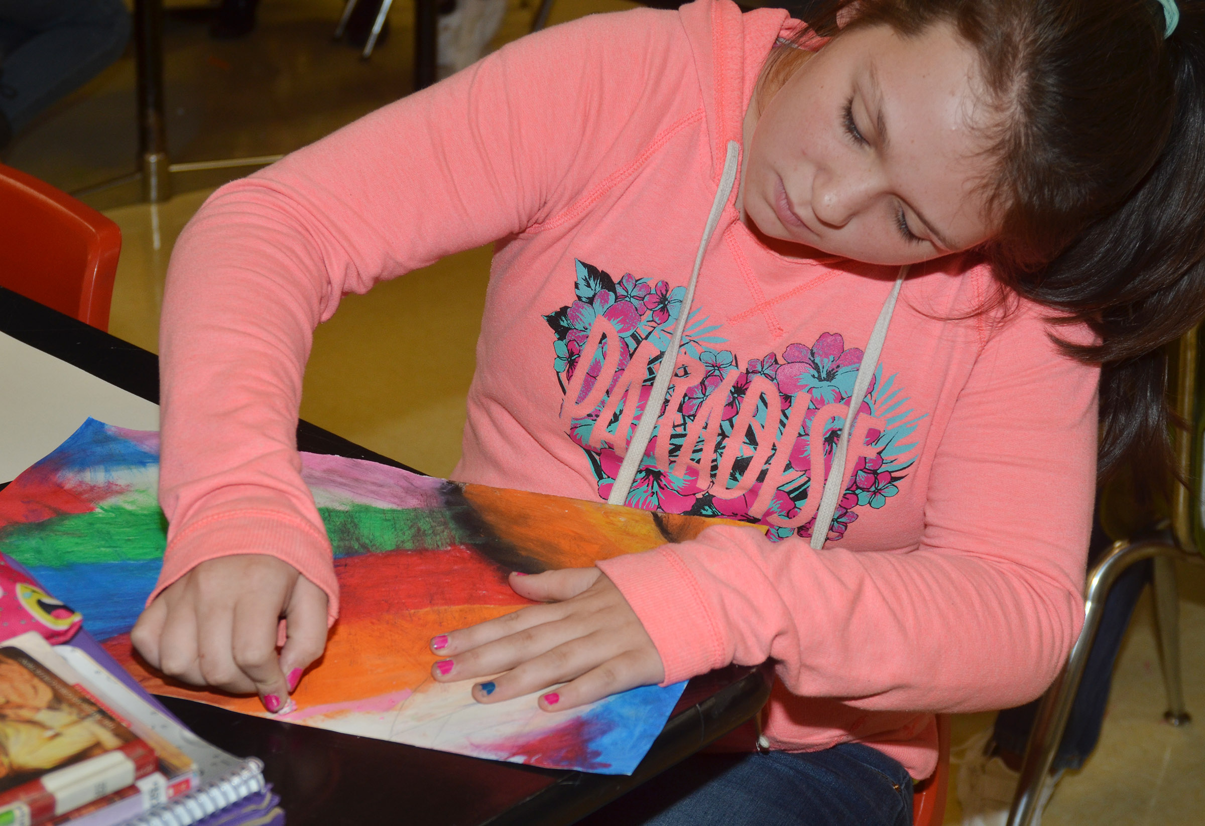 CMS sixth-grader Allie Compton adds color to her flower.
