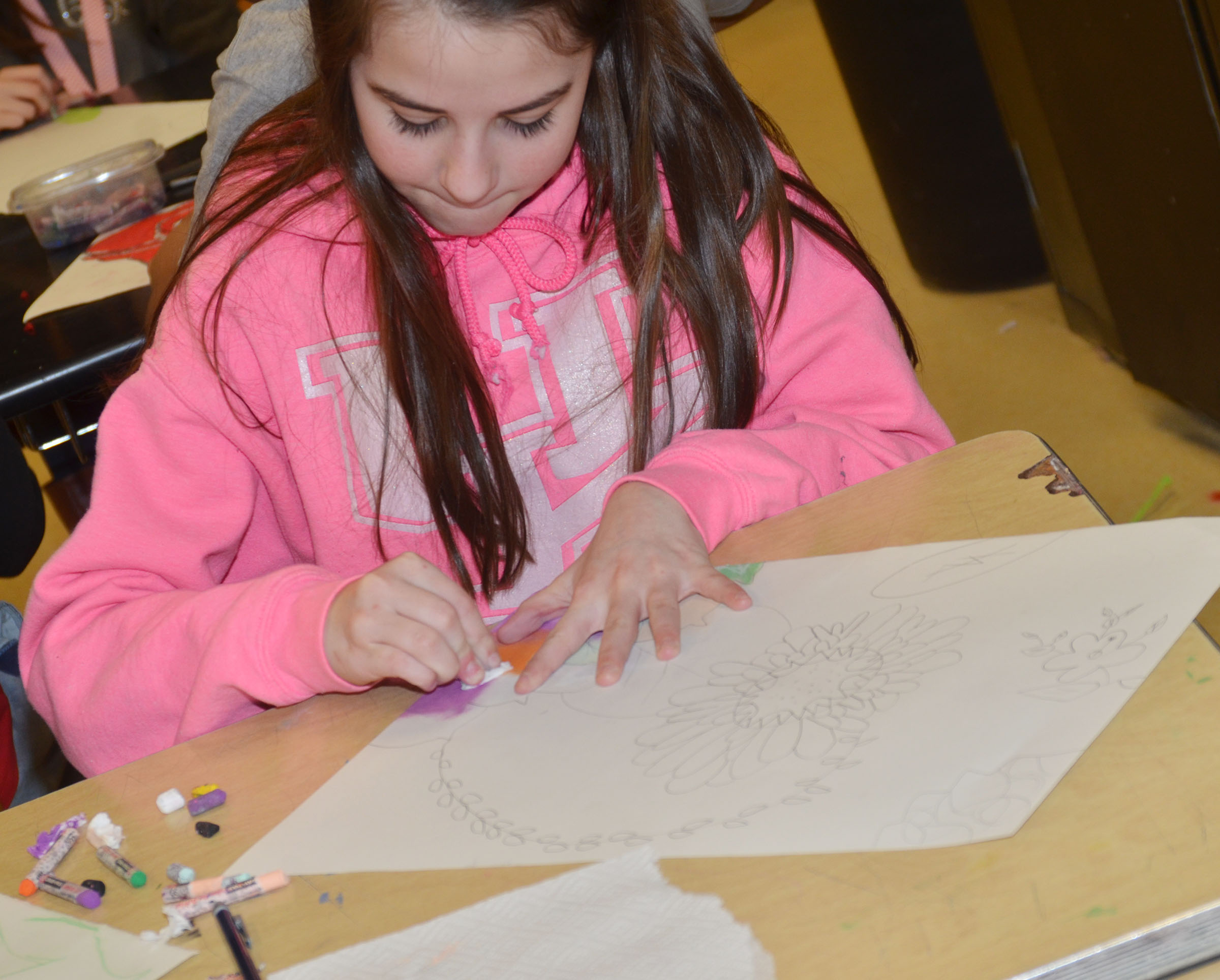 CMS seventh-grader Chloe Anderson colors her flower drawing.