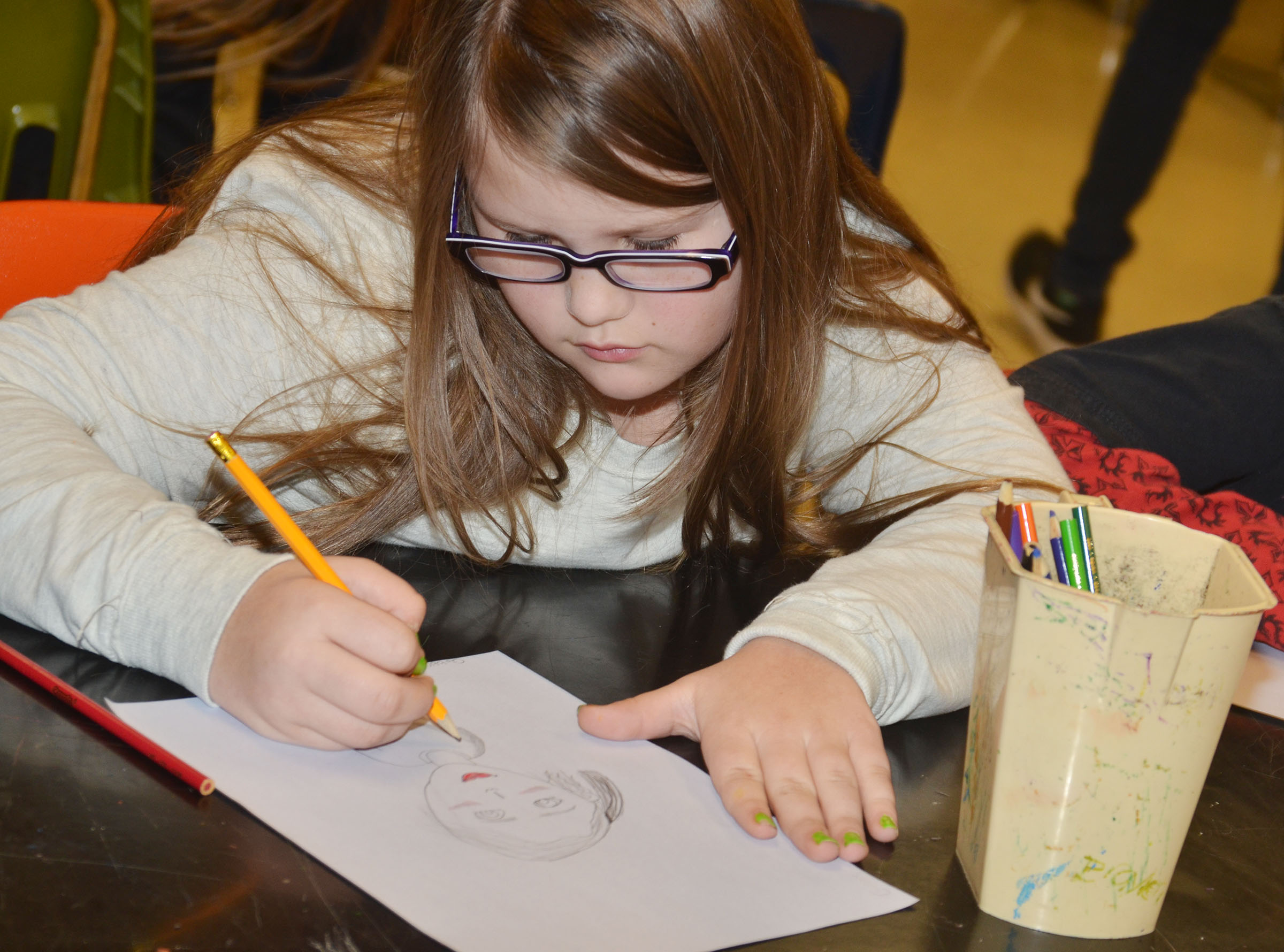 CMS fifth-grader Kylee Cox draws her partner.