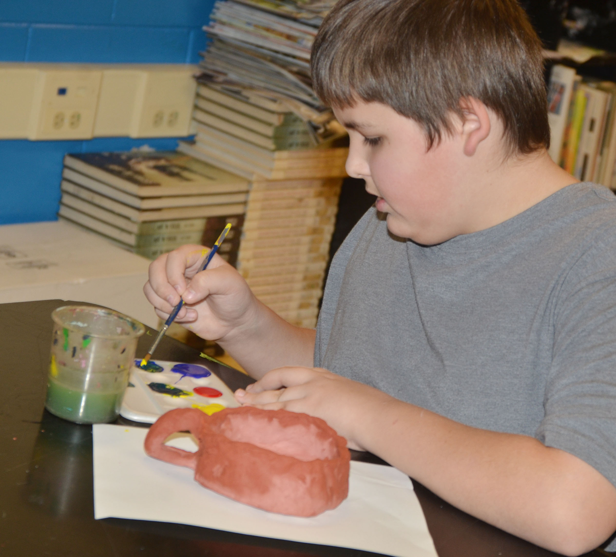CMS seventh-grader Kaine Terry paints his pot.