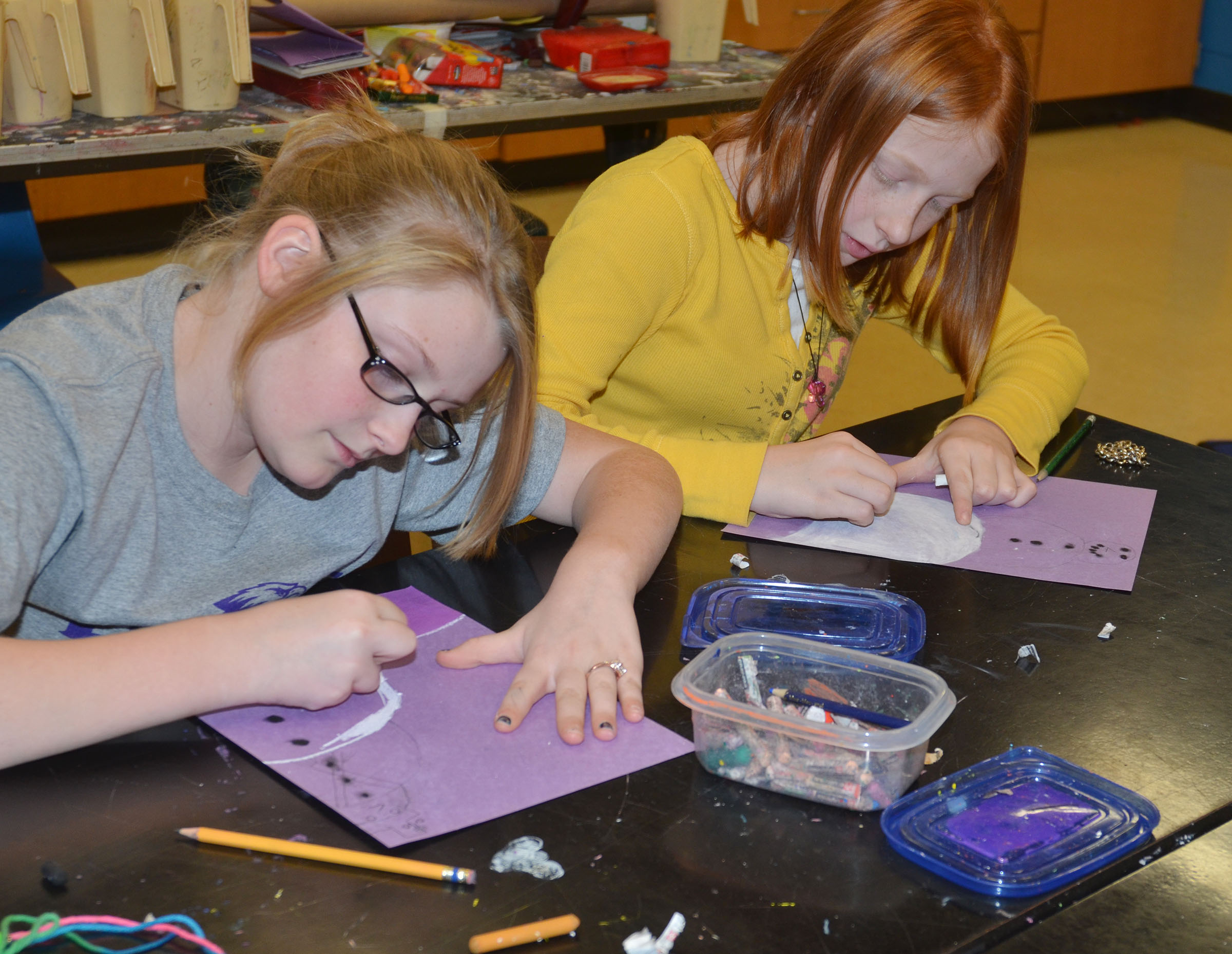 CMS fifth-graders Summer Jacobs, at left, and Kaydence Wethington color their snowmen.