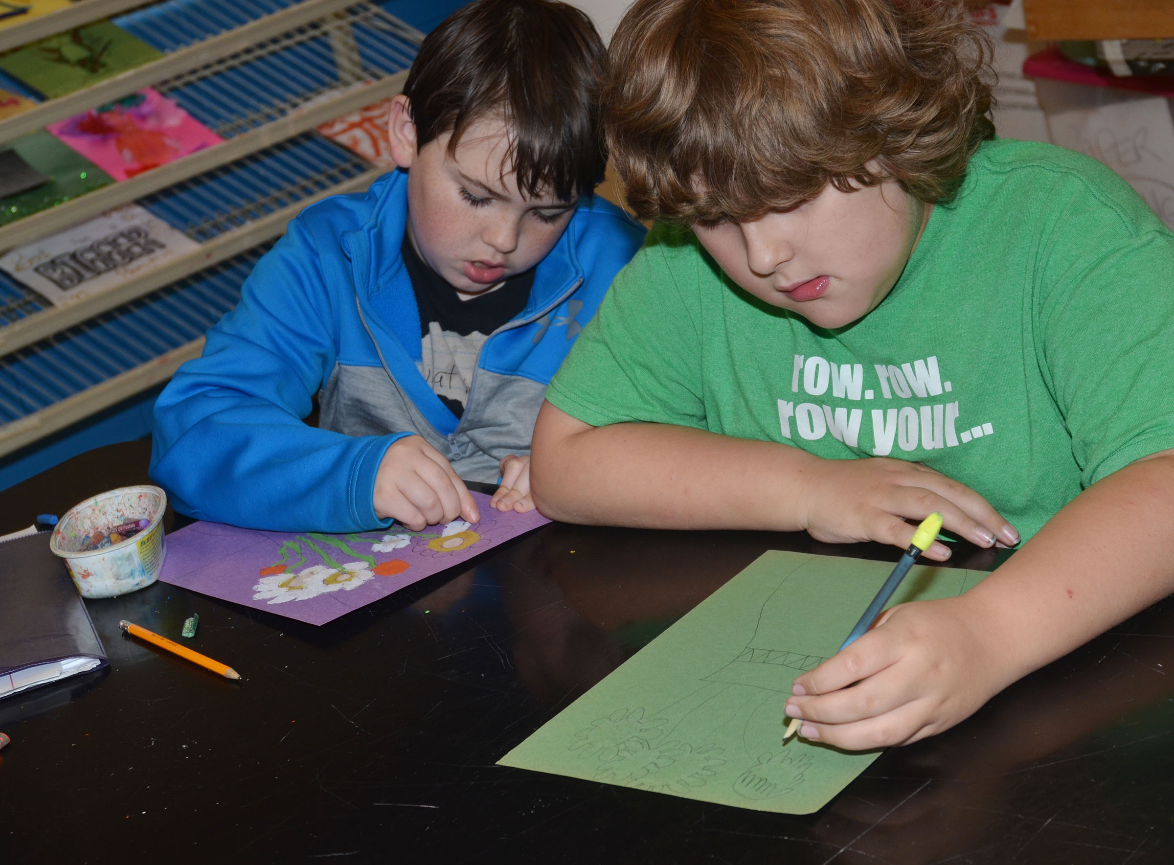 CMS fourth-graders Cody Agee, at left, and Zeke Harris work on their sunflower drawings.