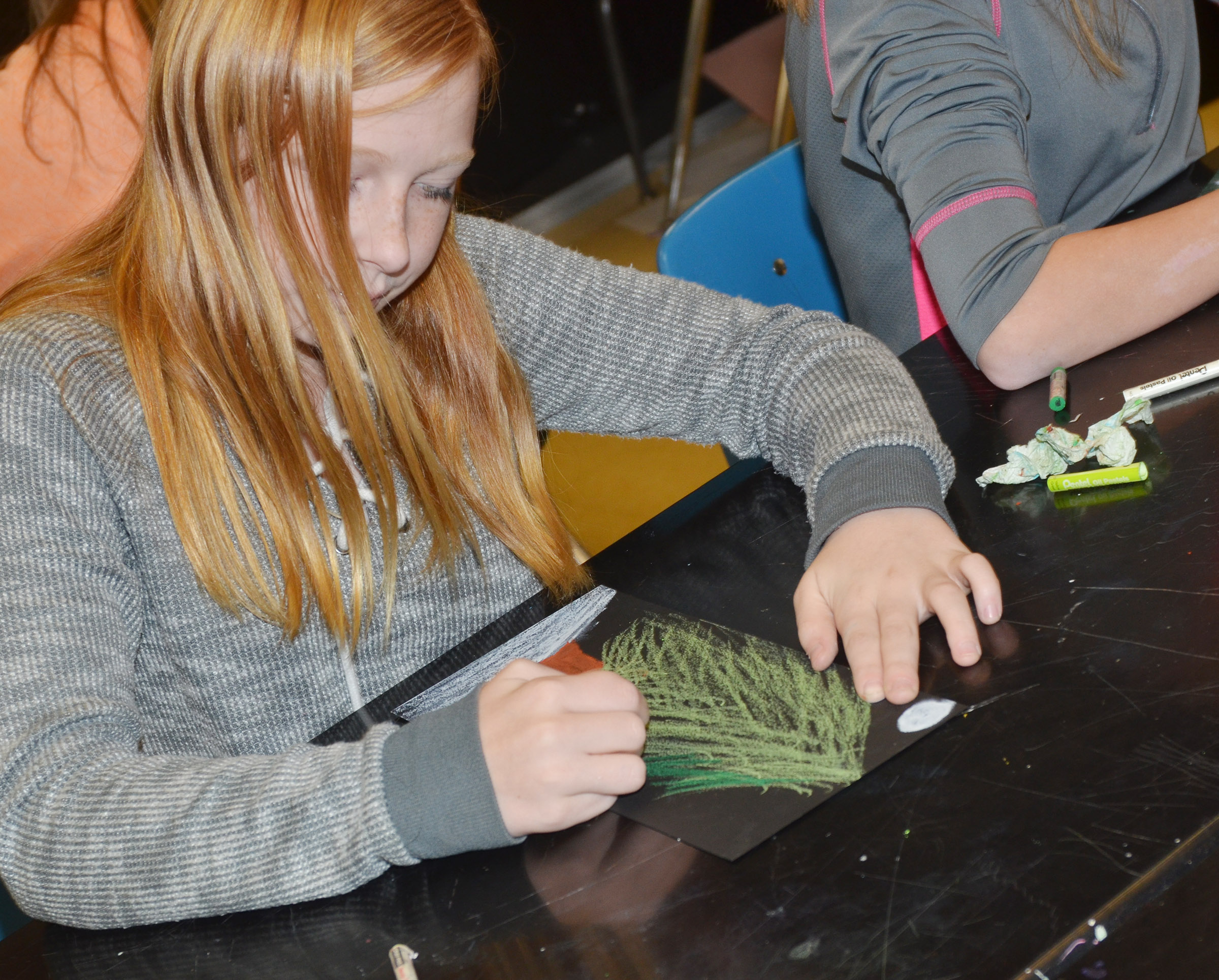 CMS sixth-grader Kaydence Wethington colors her tree.