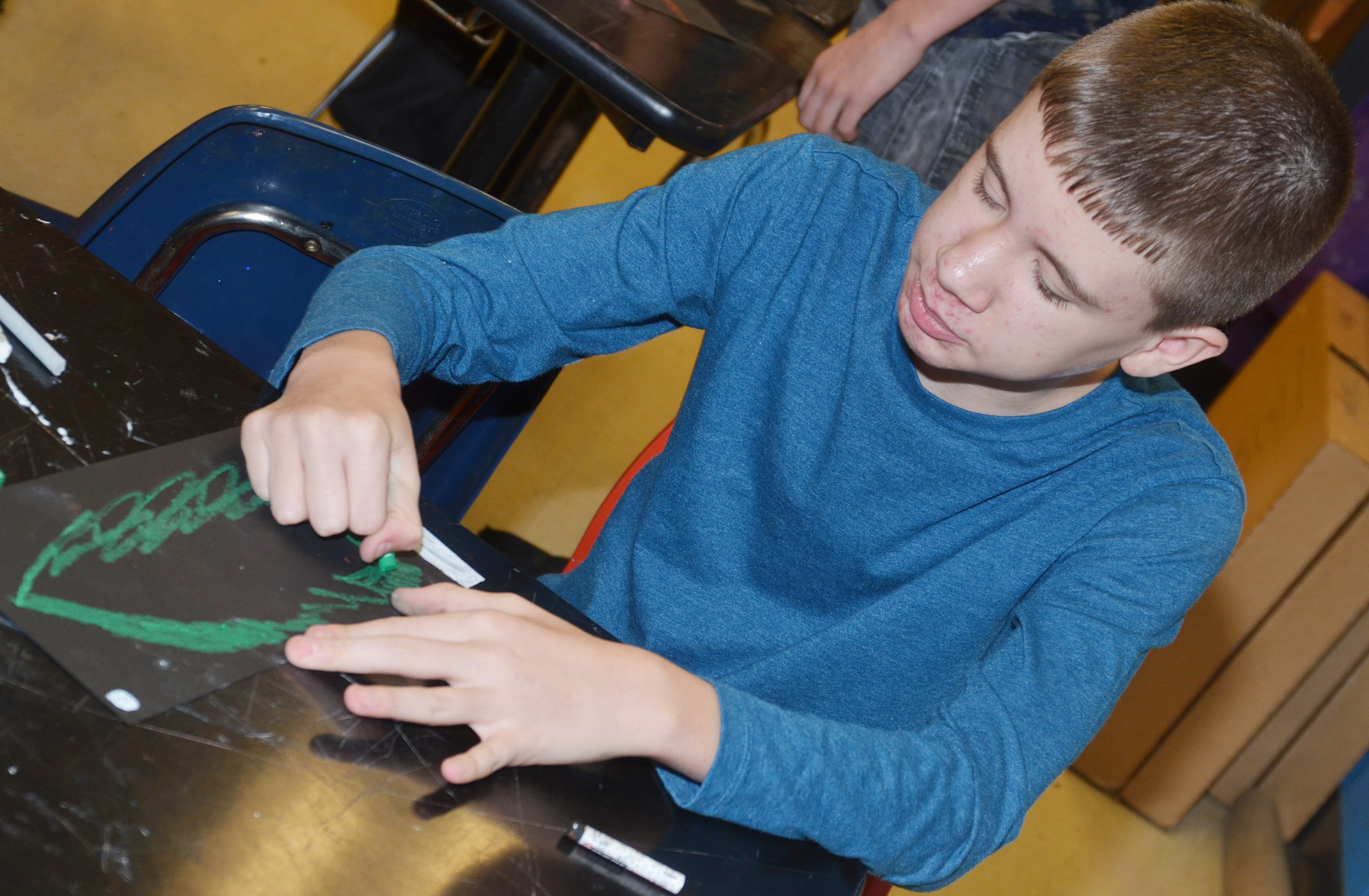 CMS seventh-grader Blake Tungate draws his tree.
