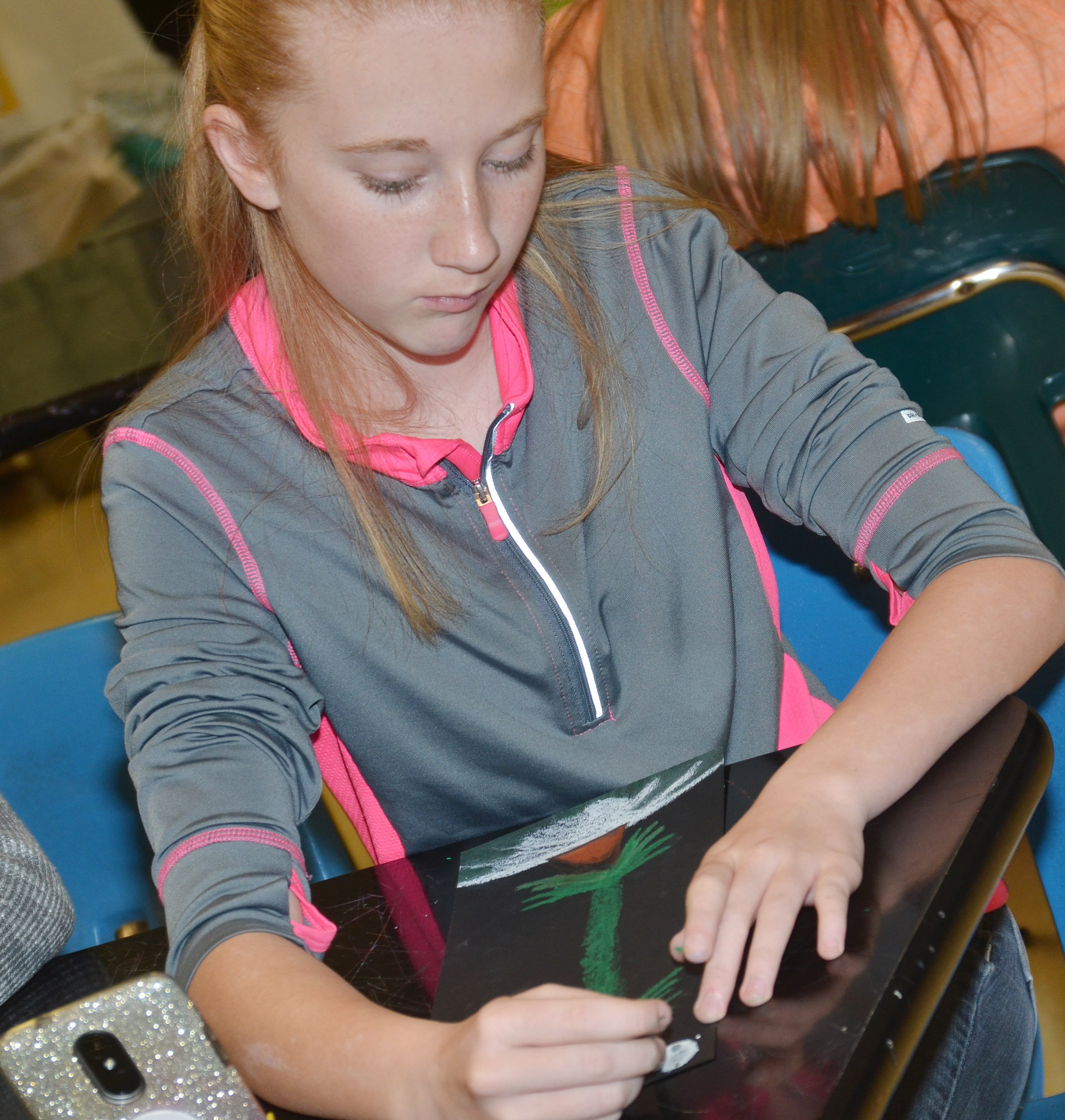 CMS eighth-grader Hayley Wethington draws her tree.