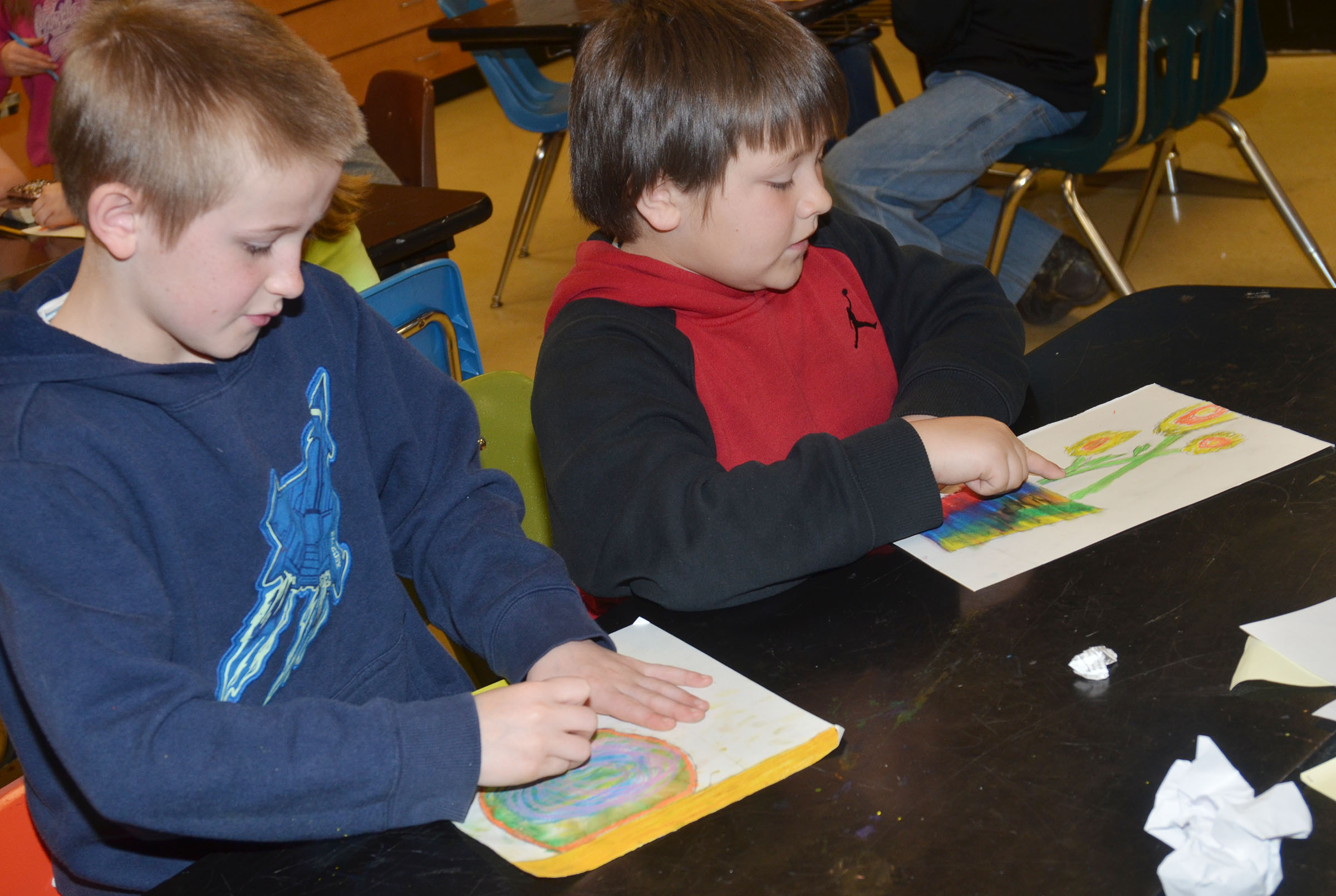 CMS fourth-grader Arthur Singleton, at left, and fifth-grader Leo Lamer color their sunflower drawings.