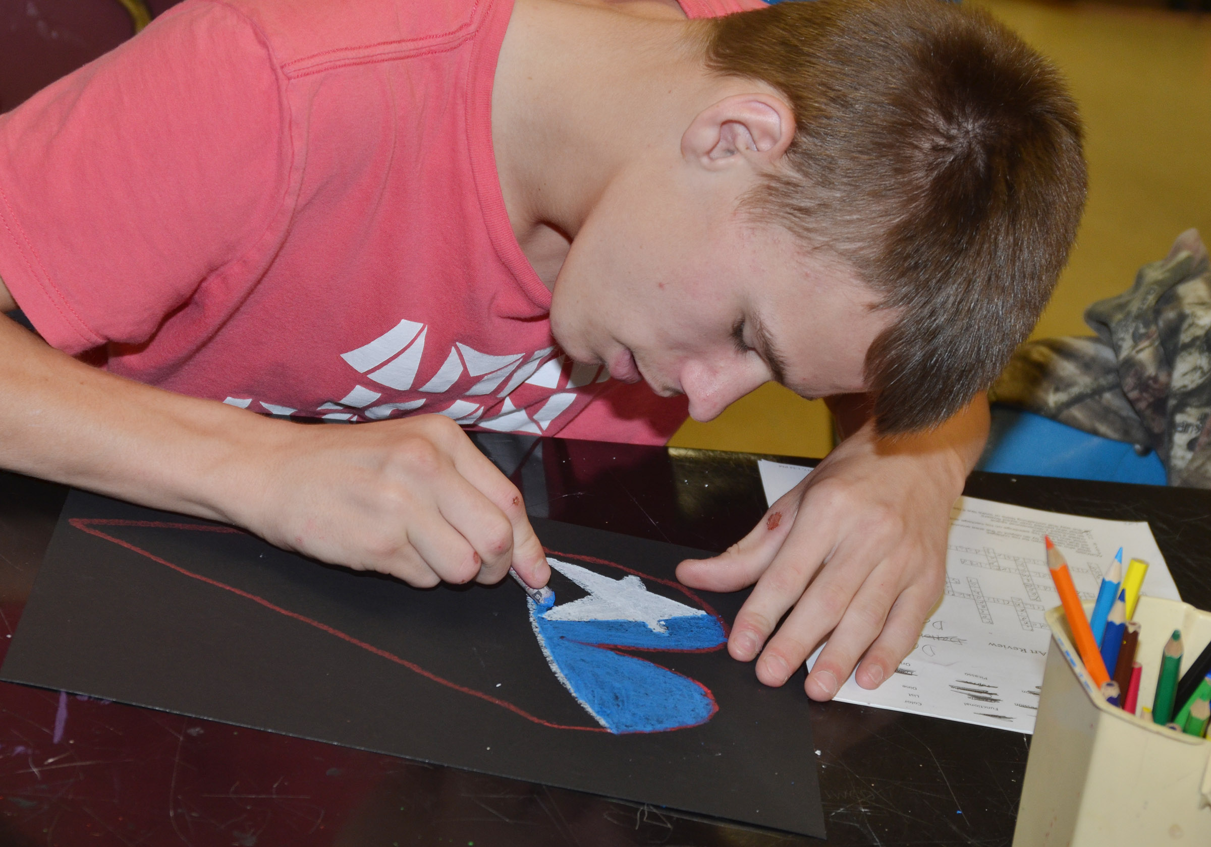 CMS eighth-grader Dalton Reynolds adds color to his heart.