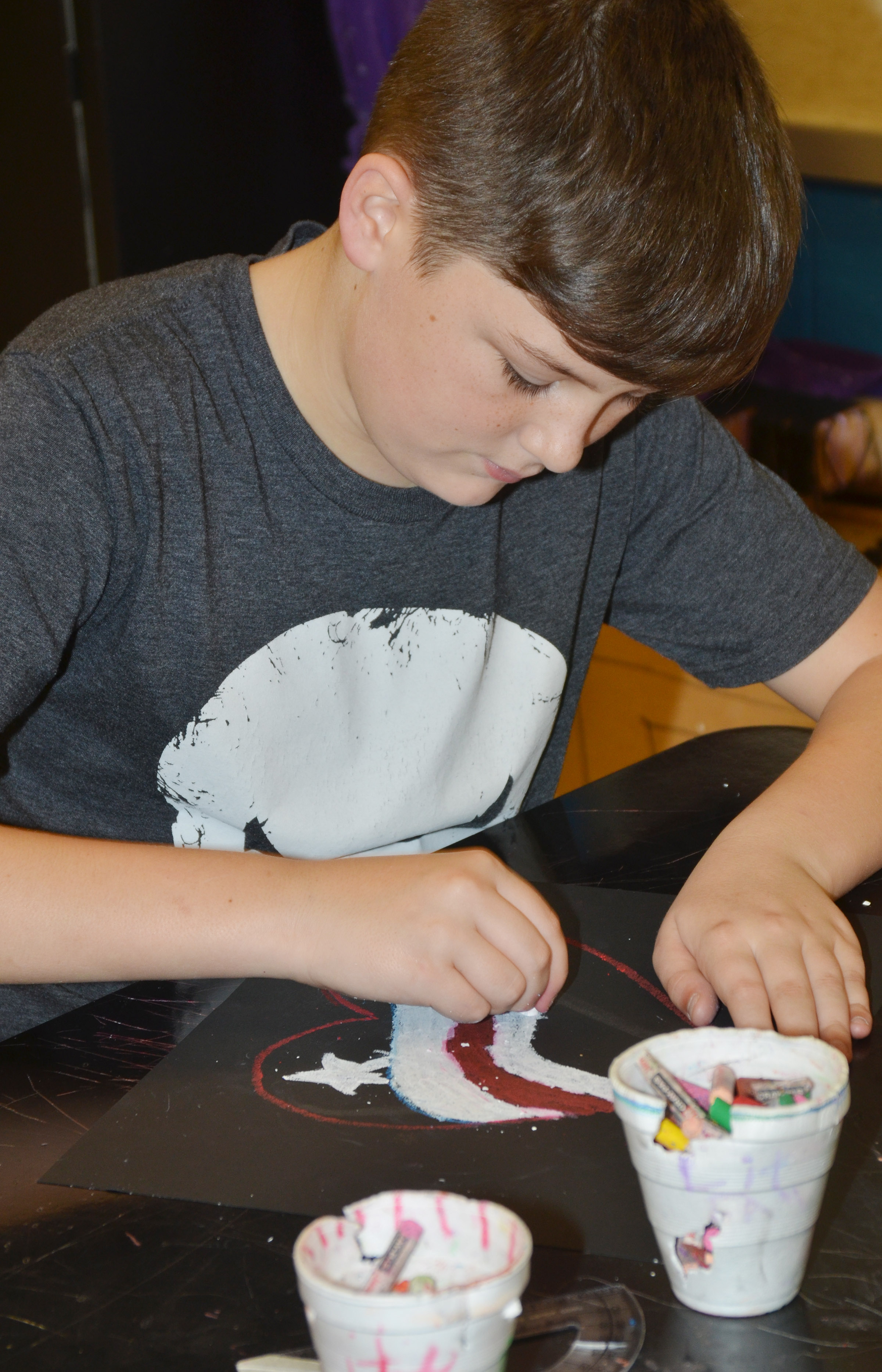 CMS eighth-grader Cohen Moon adds color to his heart.