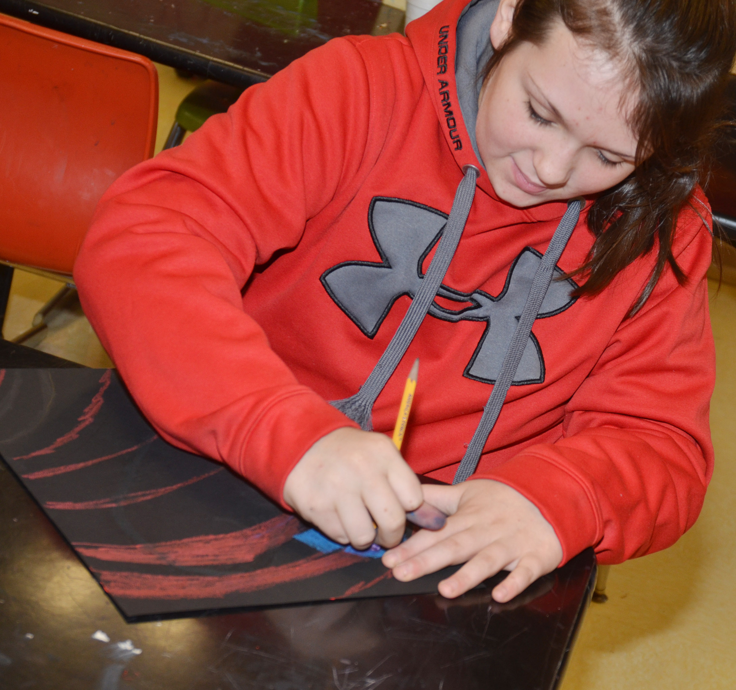 CMS sixth-grader Allie Compton adds color to her heart.