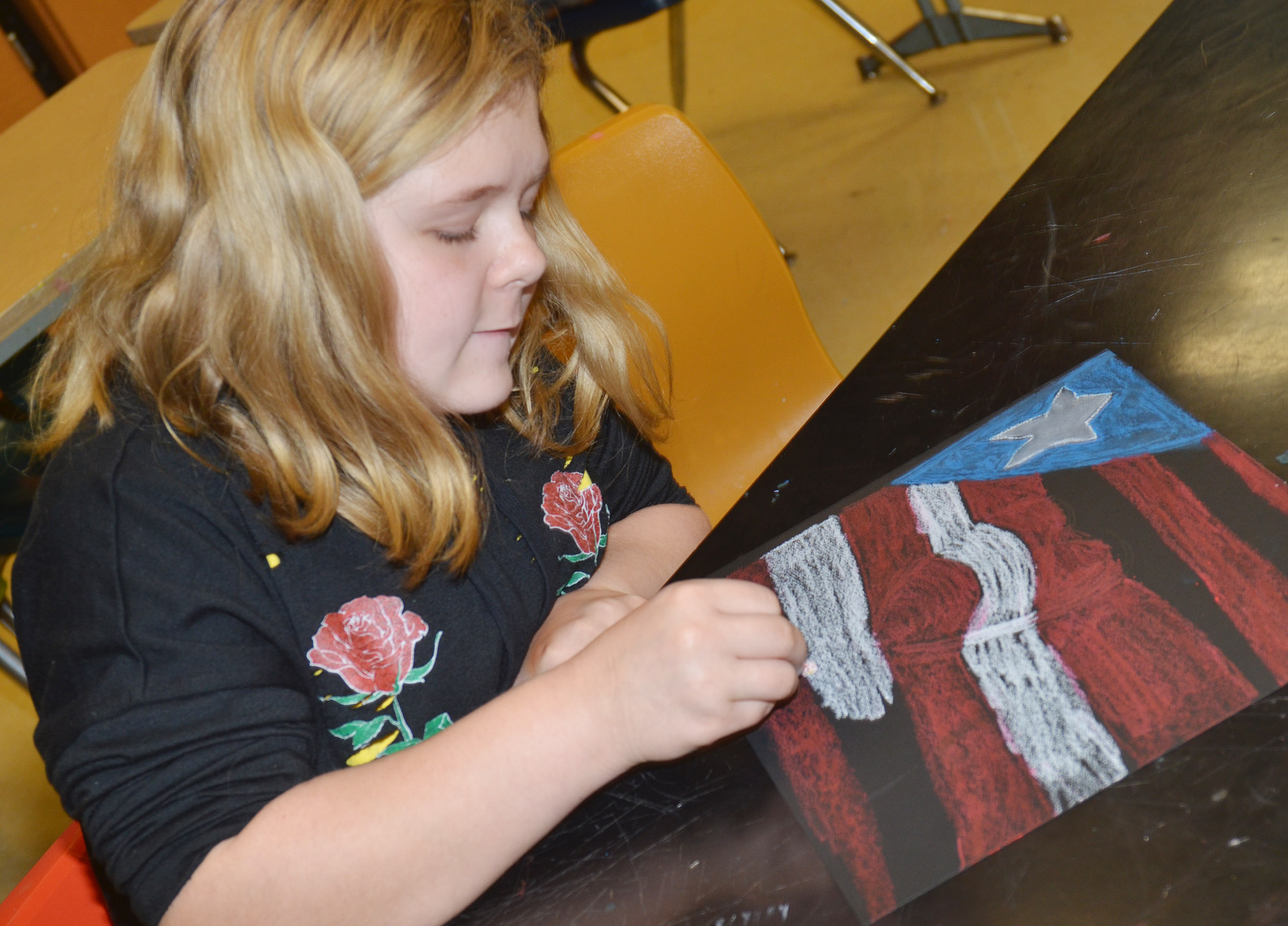 CMS sixth-grader Alexis Sharp adds color to her heart.