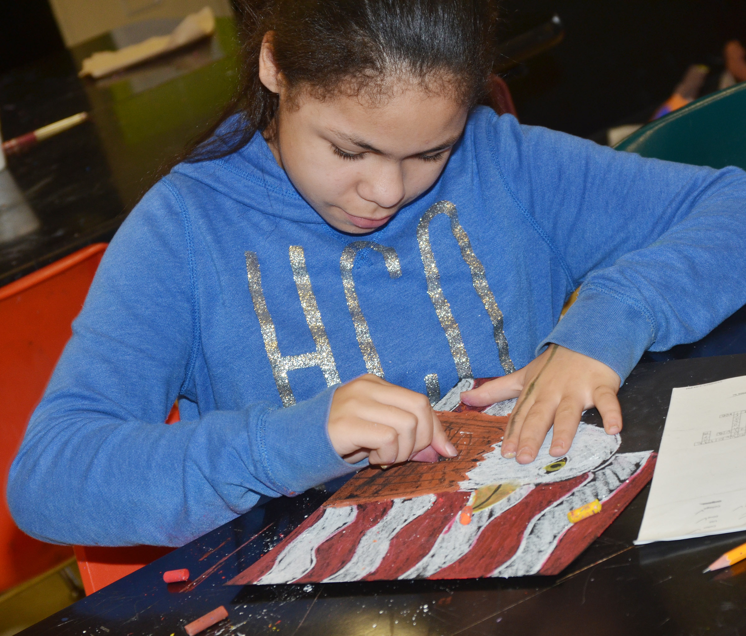 CMS sixth-grader Jayla Penn adds color to her heart.