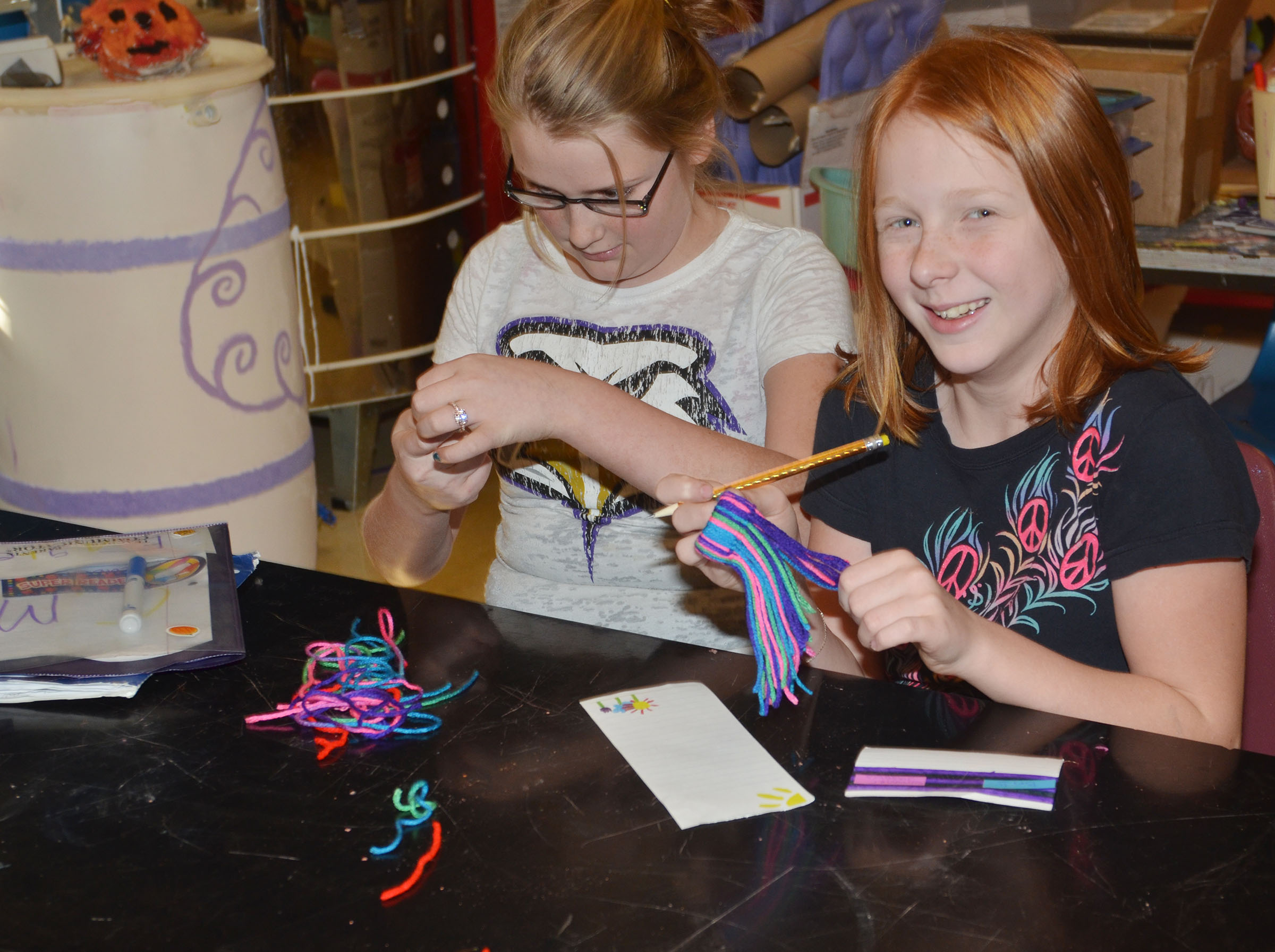 CMS fifth-graders Summer Jacobs, at left, and Kaydence Wethington make toboggans out of yarn.