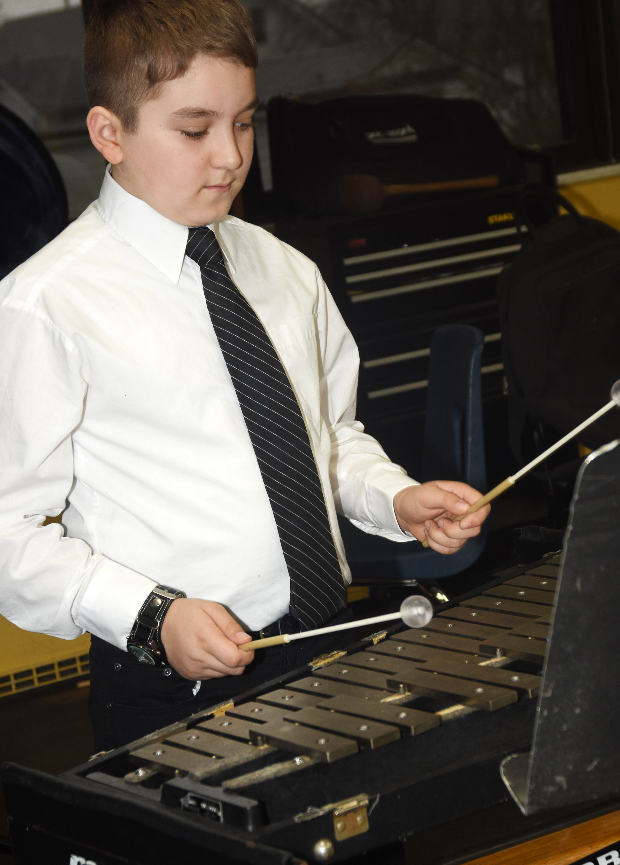 CMS sixth-grader Nathan McFarland plays percussion as the concert band practices for KMEA assessment.