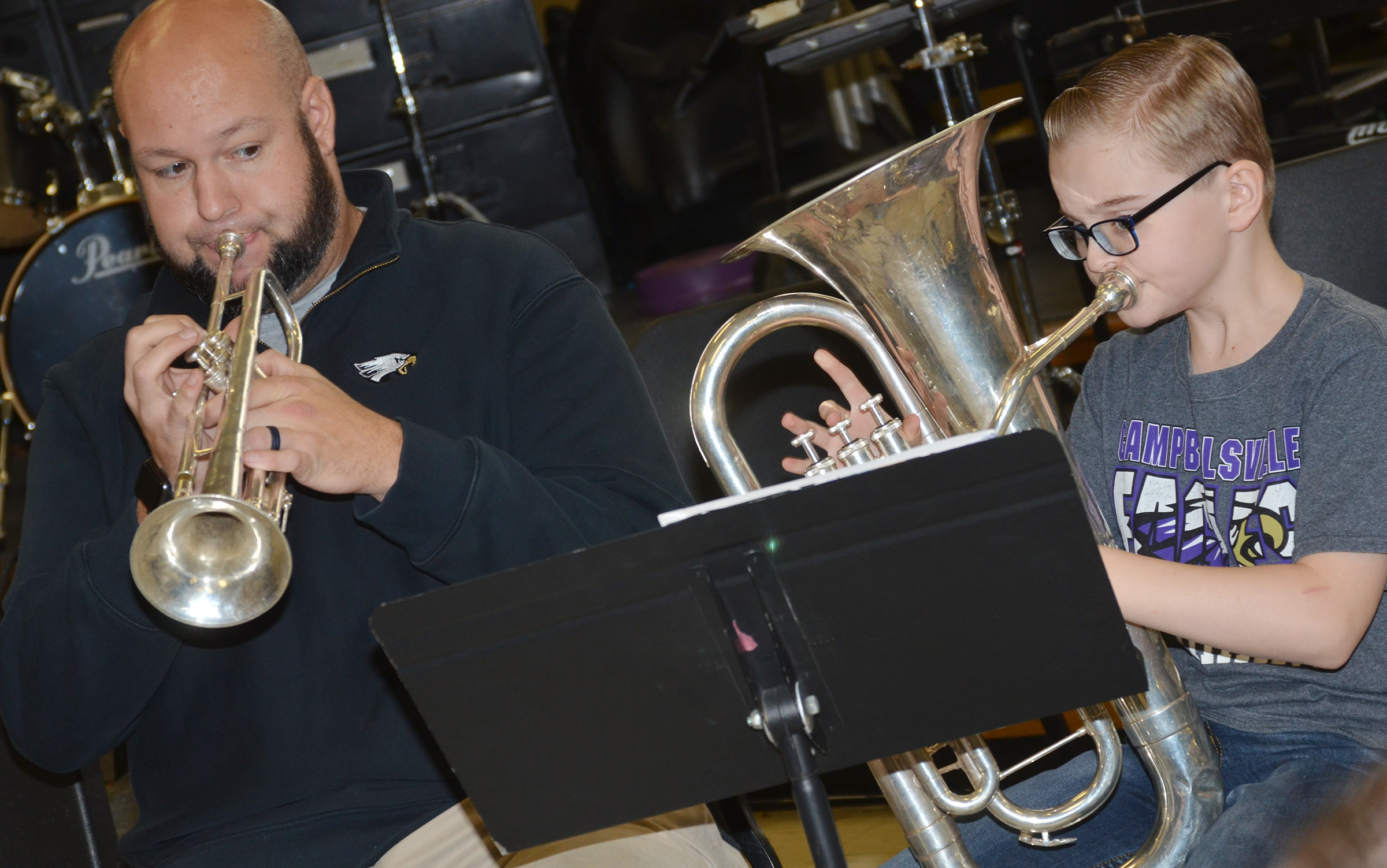 CMS band director Zach Shelton plays along with sixth-grader Caleb Holt.