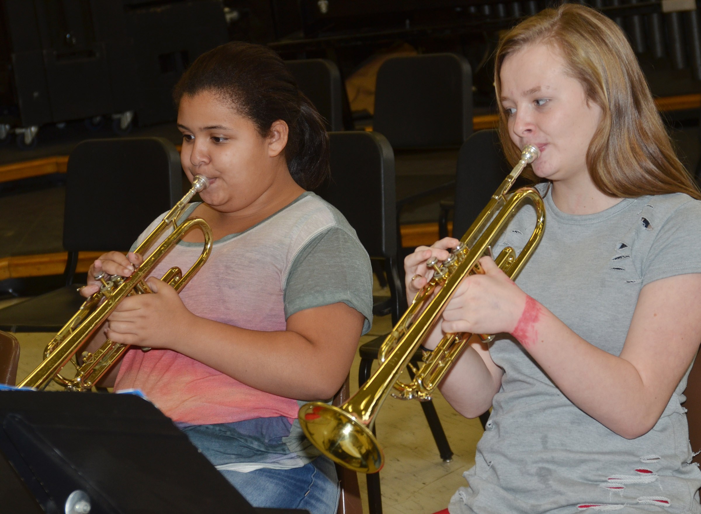 CMS sixth-grader Kyleigh Richerson, at left, and seventh-grader Davanna Reardon play the trumpet.