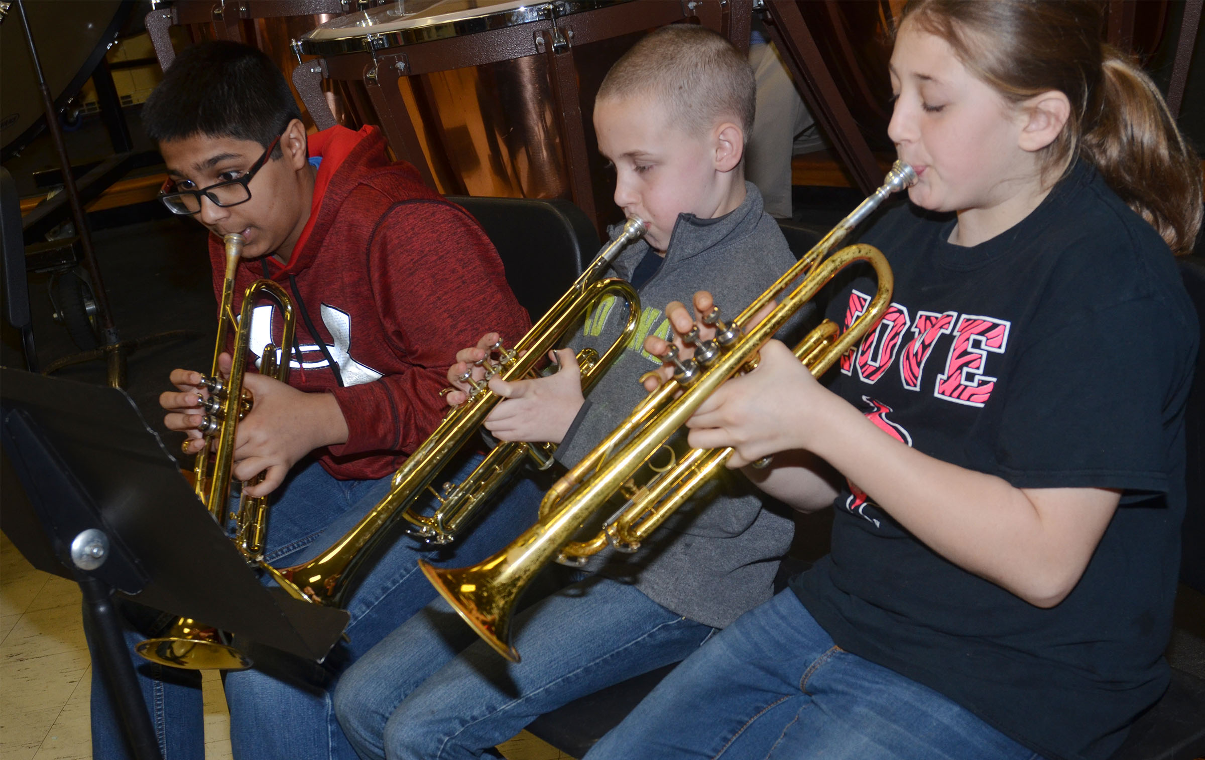 From left, CMS seventh-grader Yash Patel and sixth-graders Brandon Nelson and Jasmine Daniels play the trumpet.