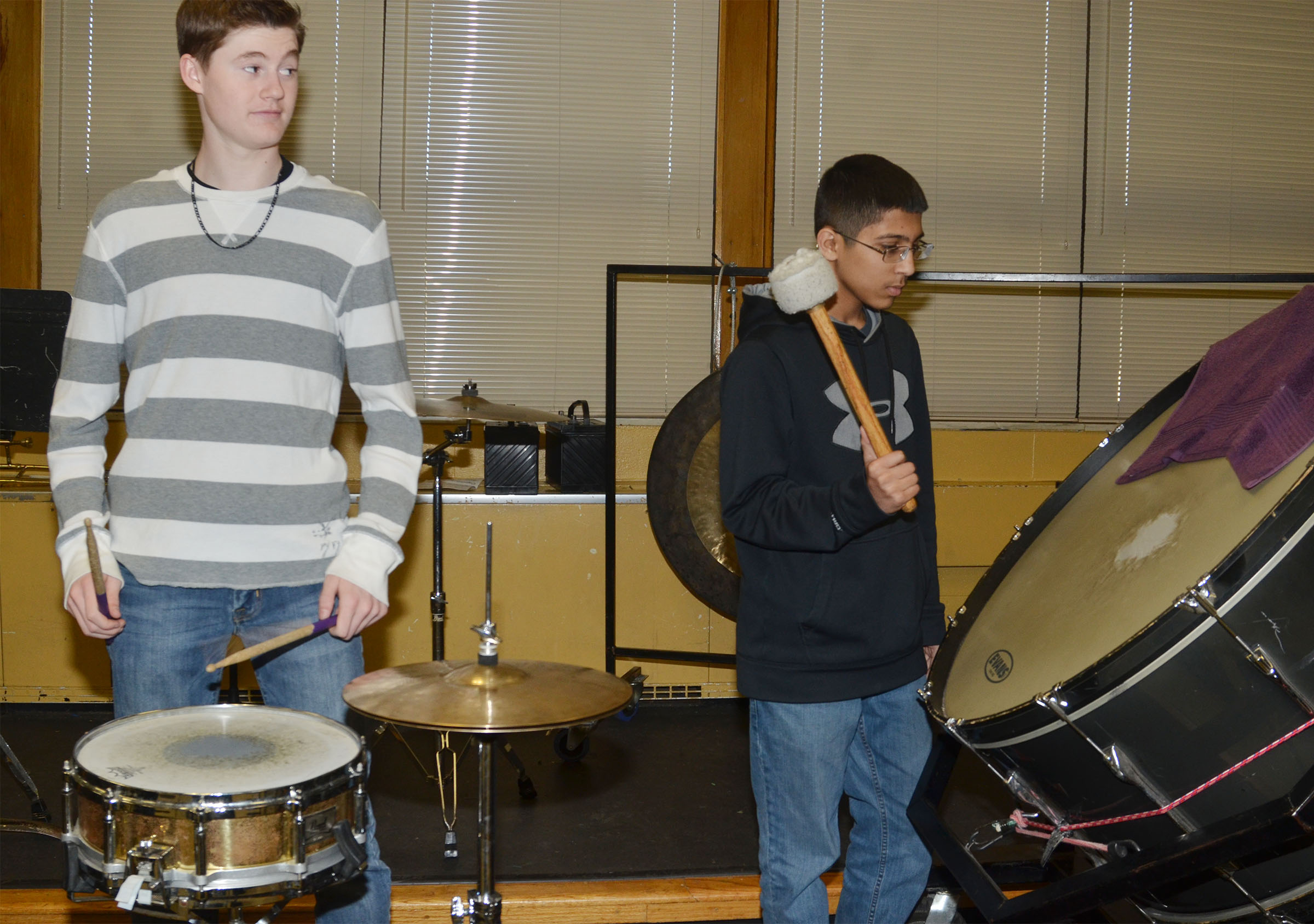 CMS eighth-graders Tristin Faulkner, at left, and Raj Patel play a song on the snare and bass drum.