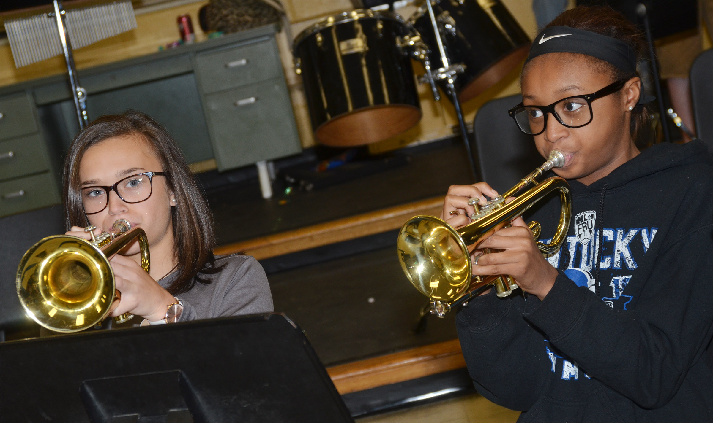 CMS seventh-graders Tayler Thompson, at left, and Bri Gowdy play trumpet.