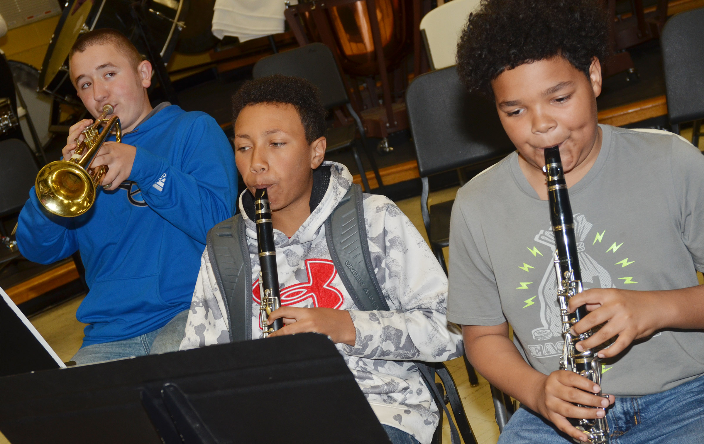From left, CMS seventh-grader Zachary Shaw plays trumpet and eighth-graders Jastyn Shively and Alex Lofton play clarinet.