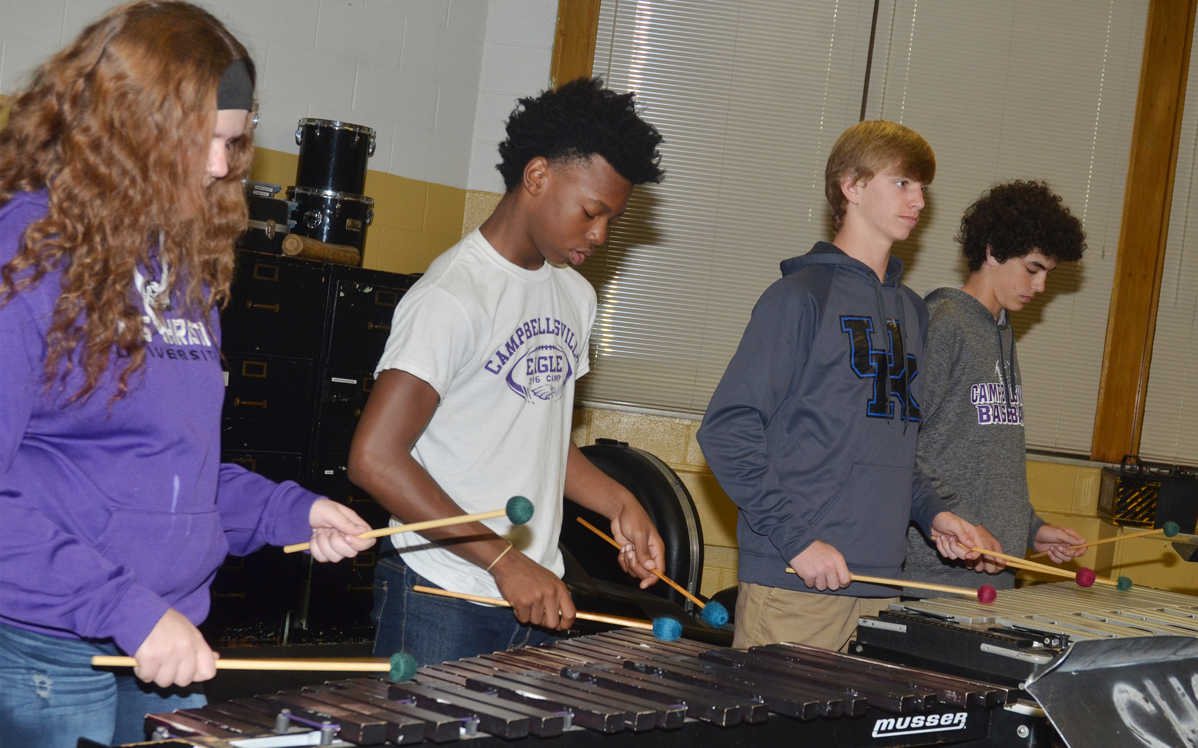 CMS eighth-graders, from left, Autumn Brown, Sae'von Buckner, Arren Hash and Kameron Smith play percussion.