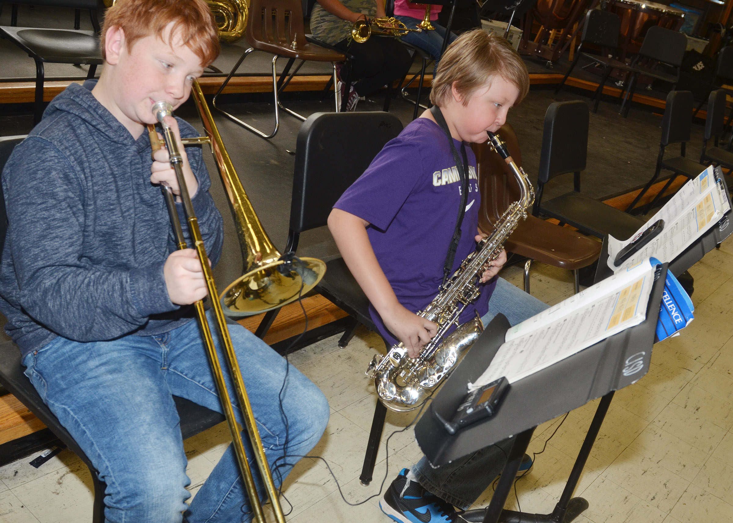 "CMS sixth-graders Conner Rinehart, at left, and Zachary Akin play ""The Riddle Song."""