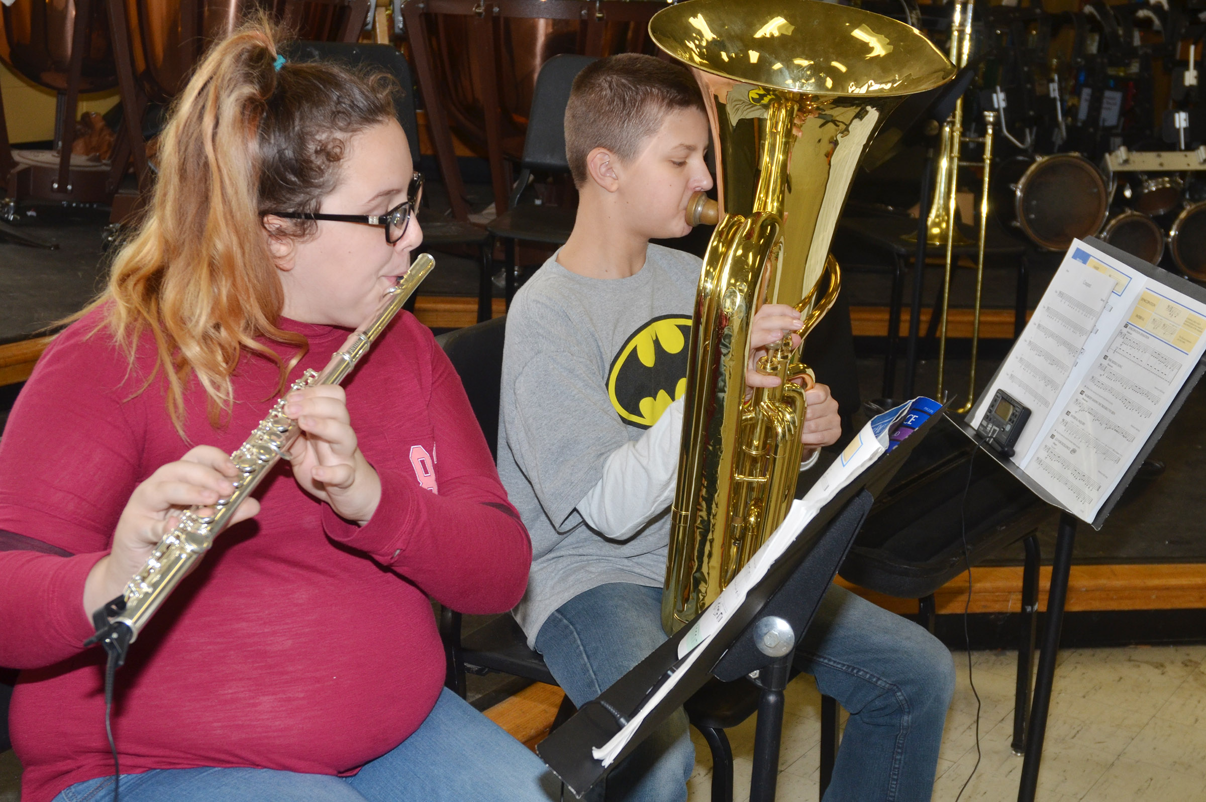 "CMS seventh-graders Sierra Houk, at left, and Tyler Booth play ""The Riddle Song."""