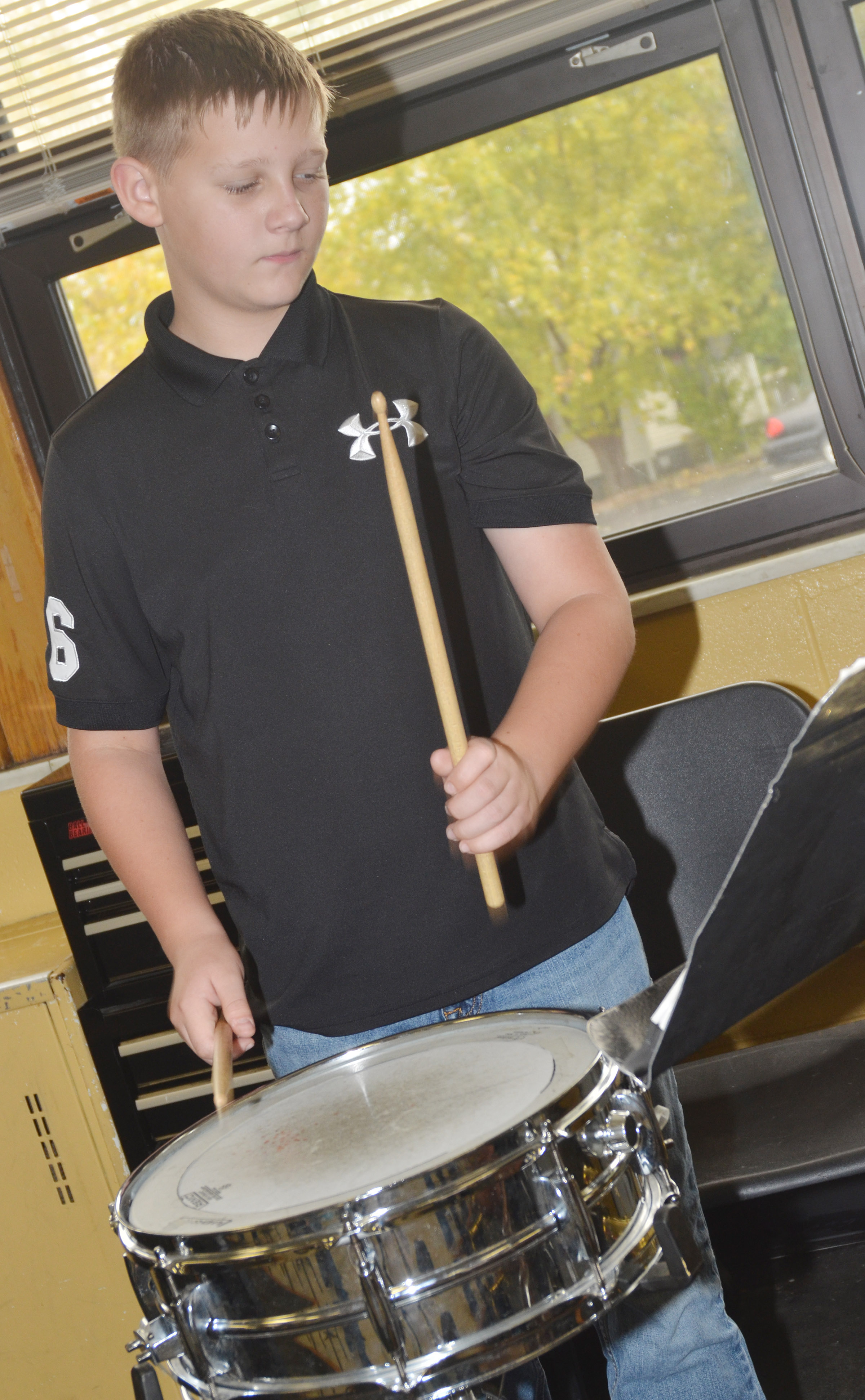 CMS sixth-grader Jesse King plays snare drum.